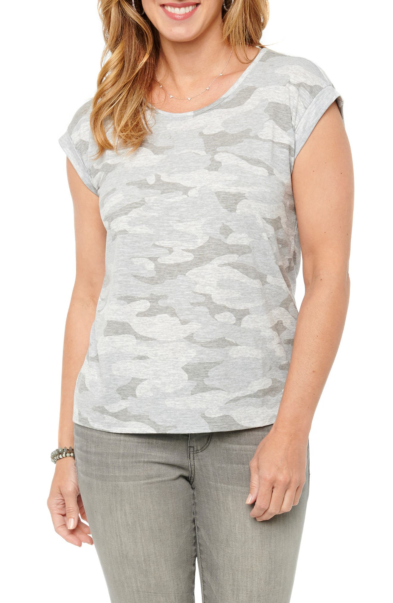 An everyday staple gets a literal twist on this back-keyhole T-shirt cut from a lightweight jersey with a faded camo print. Super-short dolman sleeves with folded cuffs give it an almost muscle-like fit, while a curved hemline completes the laid-back look. Style Name: Wit & Wisdom Twist Back Camo T-Shirt (Nordstrom Exclusive). Style Number: 6039875. Available in stores.
