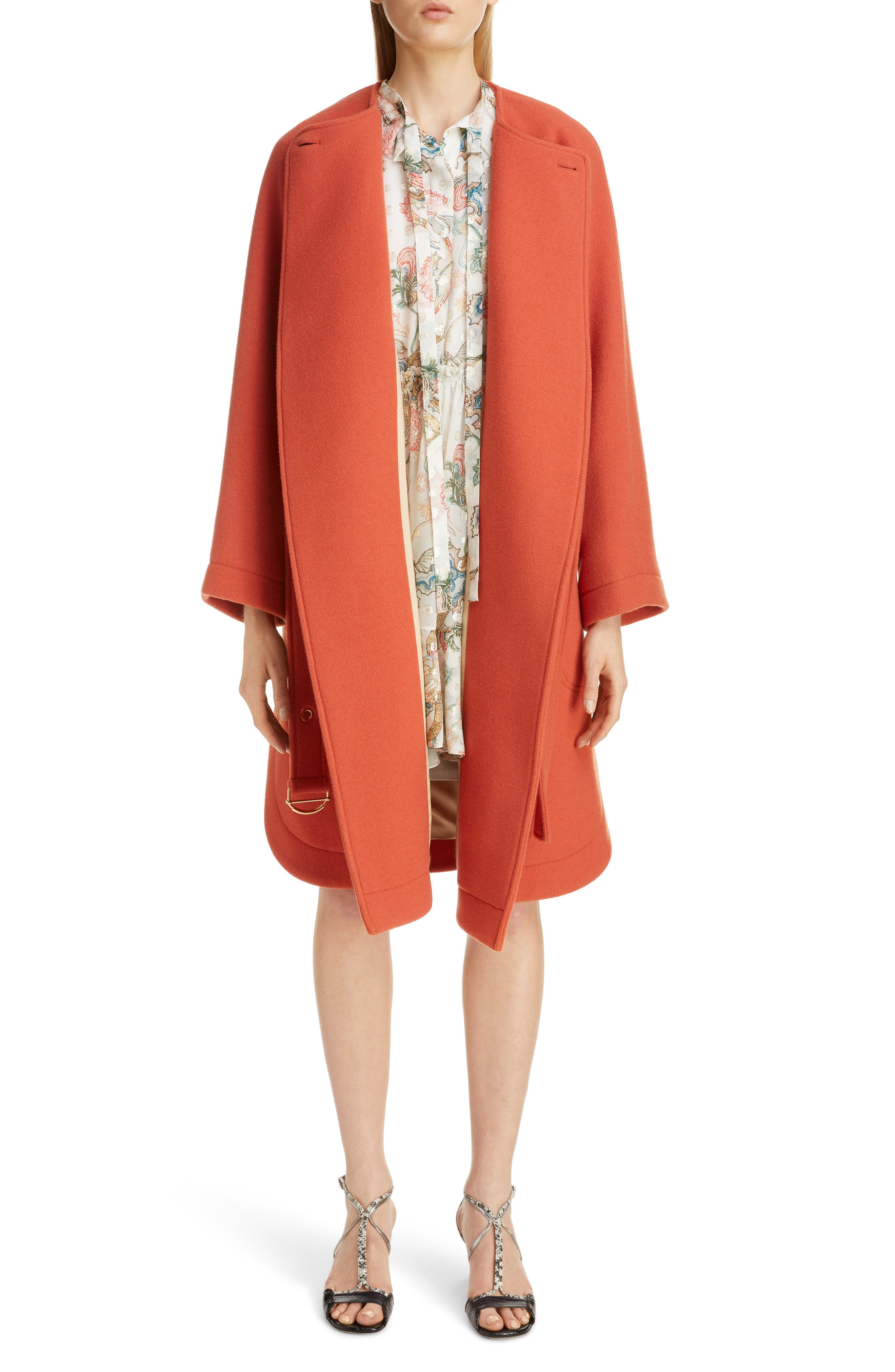 A big single button, bracelet sleeves and rounded hems add vintage charm to this beautiful virgin wool-blend coat done in a pretty chestnut-orange hue. Style Name: Chloe Iconic Wool Blend Coat. Style Number: 5940676. Available in stores.
