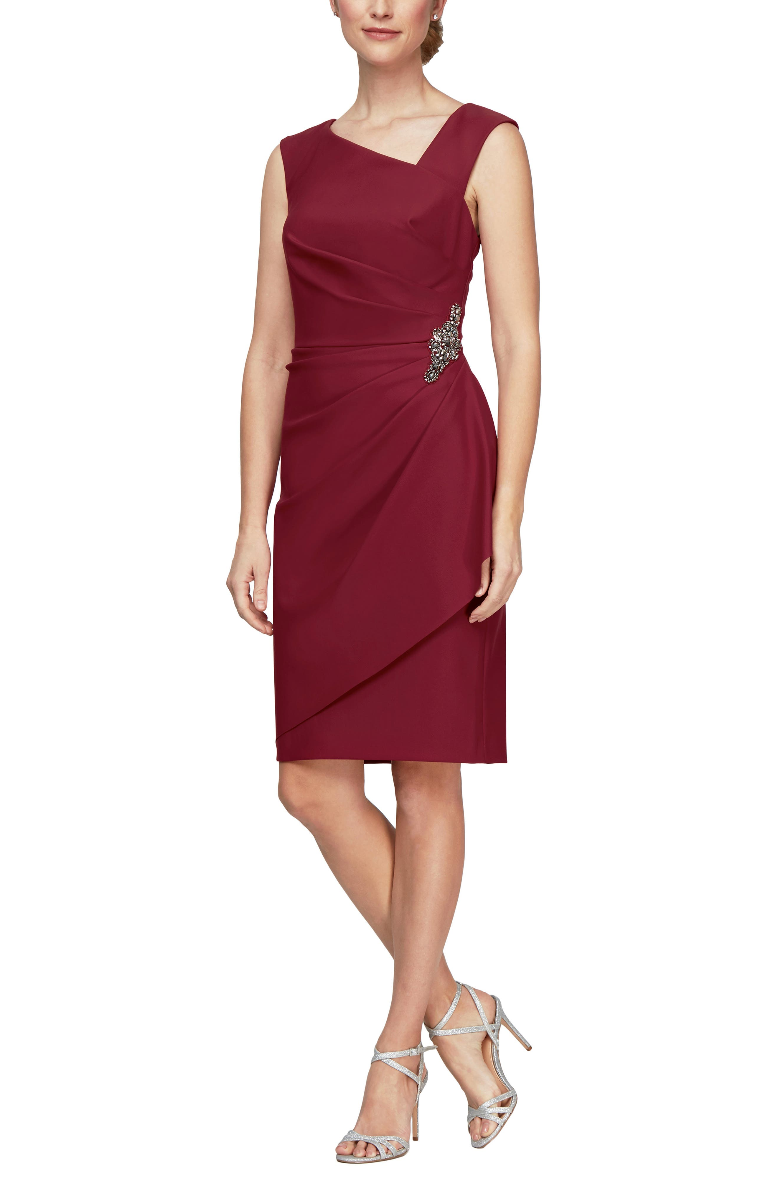 Steal this show in this sleeveless dress with a stunning asymmetrical neckline featuring figure-enhancing gathers punctuated with a sparkly side brooch. Style Name: Alex Evenings Sleeveless Sheath Dress. Style Number: 6128355. Available in stores.
