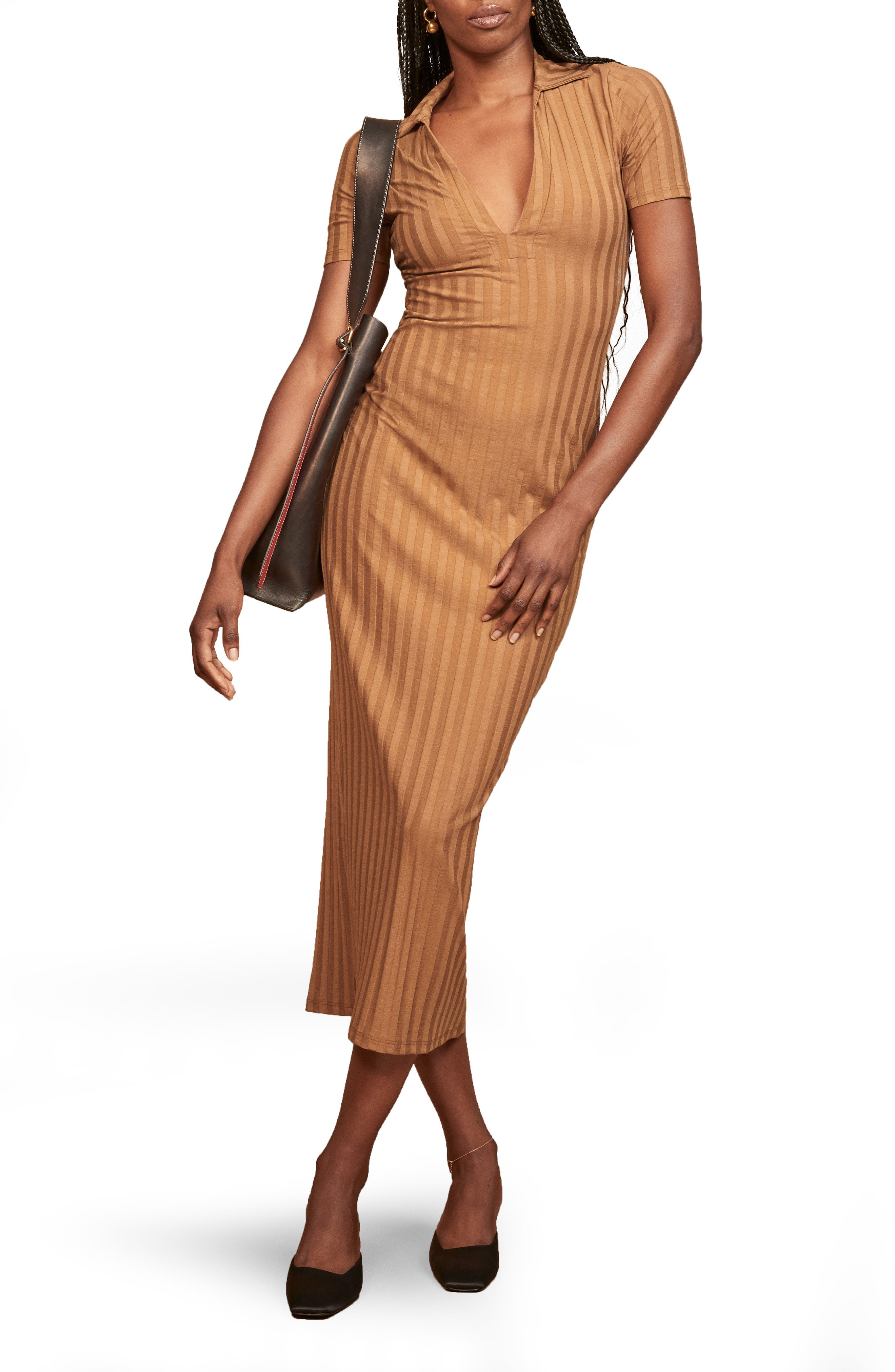 Abbreviated sleeves frame this shapely striped midi styled with a deep V-neckline and flattering tonal stripes. Style Name: Reformation Lumi Stripe Midi Dress. Style Number: 6116734. Available in stores.