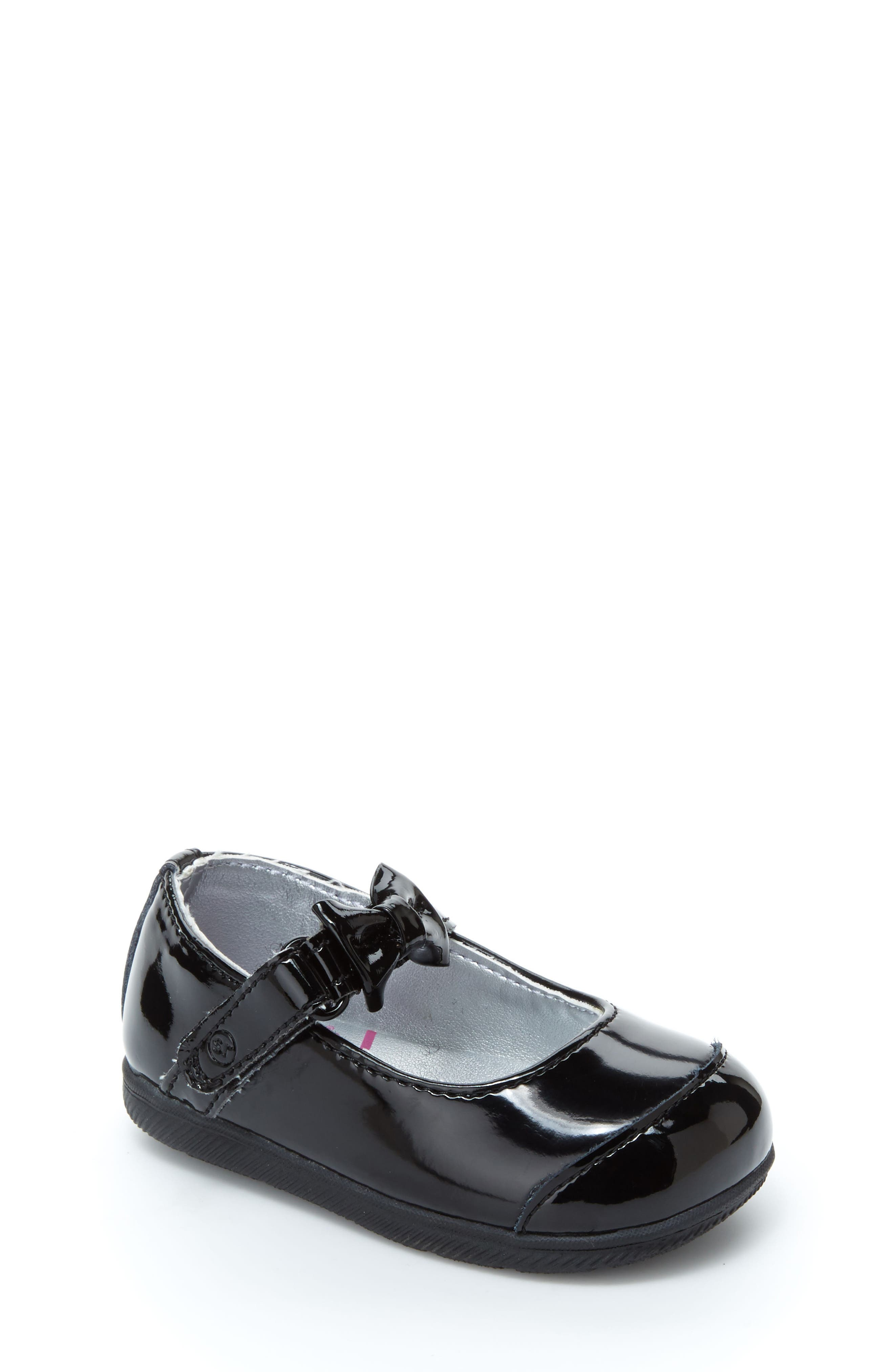 A perfect little bow adorns the mary-jane strap of this patent leather crib shoe outfitted with a charming cap toe. Style Name: Stride Rite Mirren Mary Jane (Baby). Style Number: 5215599. Available in stores.