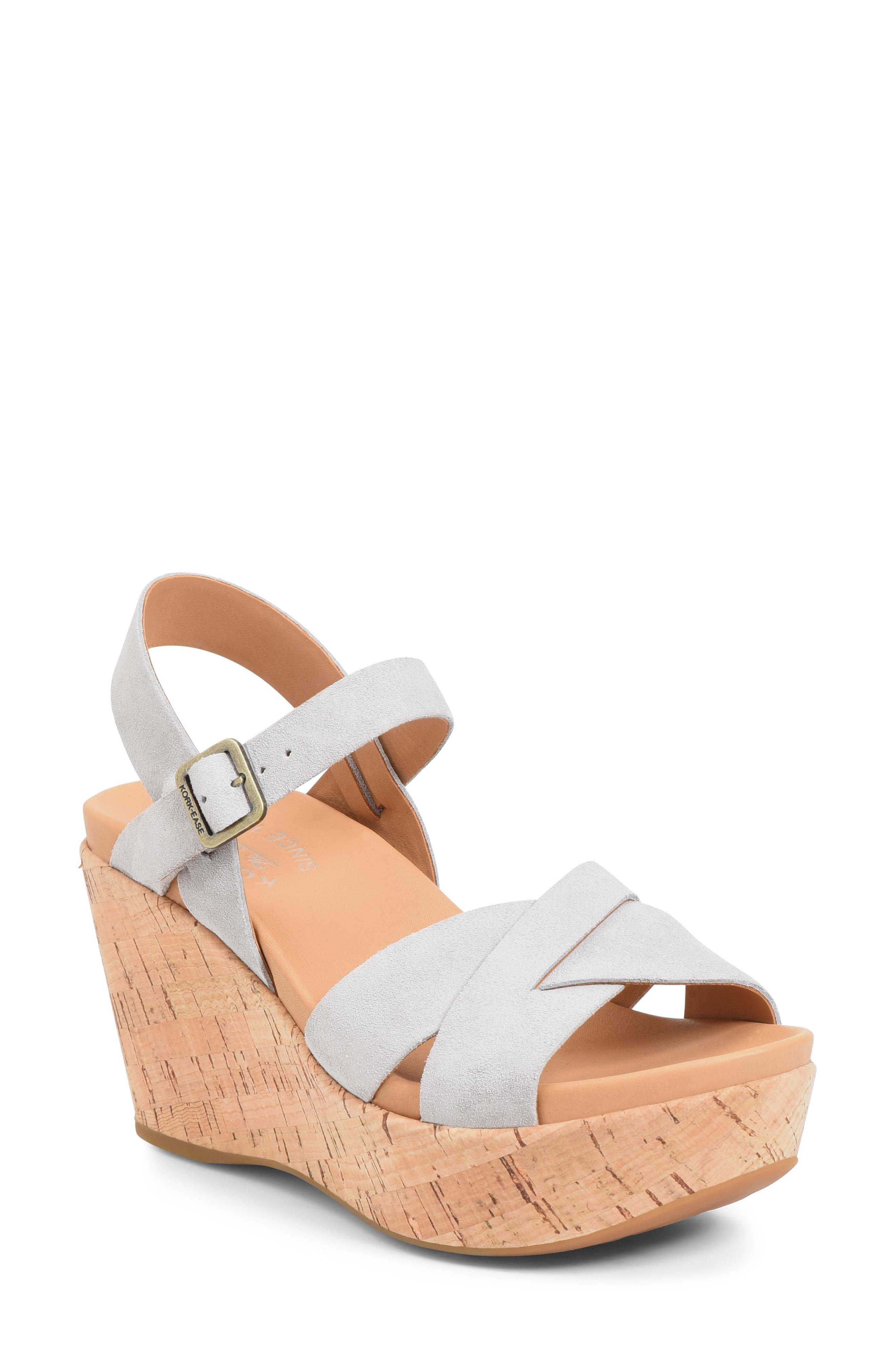 A standby comfort sandal takes a retro-chic turn with a bold platform wedge and sleek, interwoven leather straps. Style Name: Kork-Ease \\\'Ava 2.0\\\' Platform Wedge Sandal (Women). Style Number: 1024958. Available in stores.