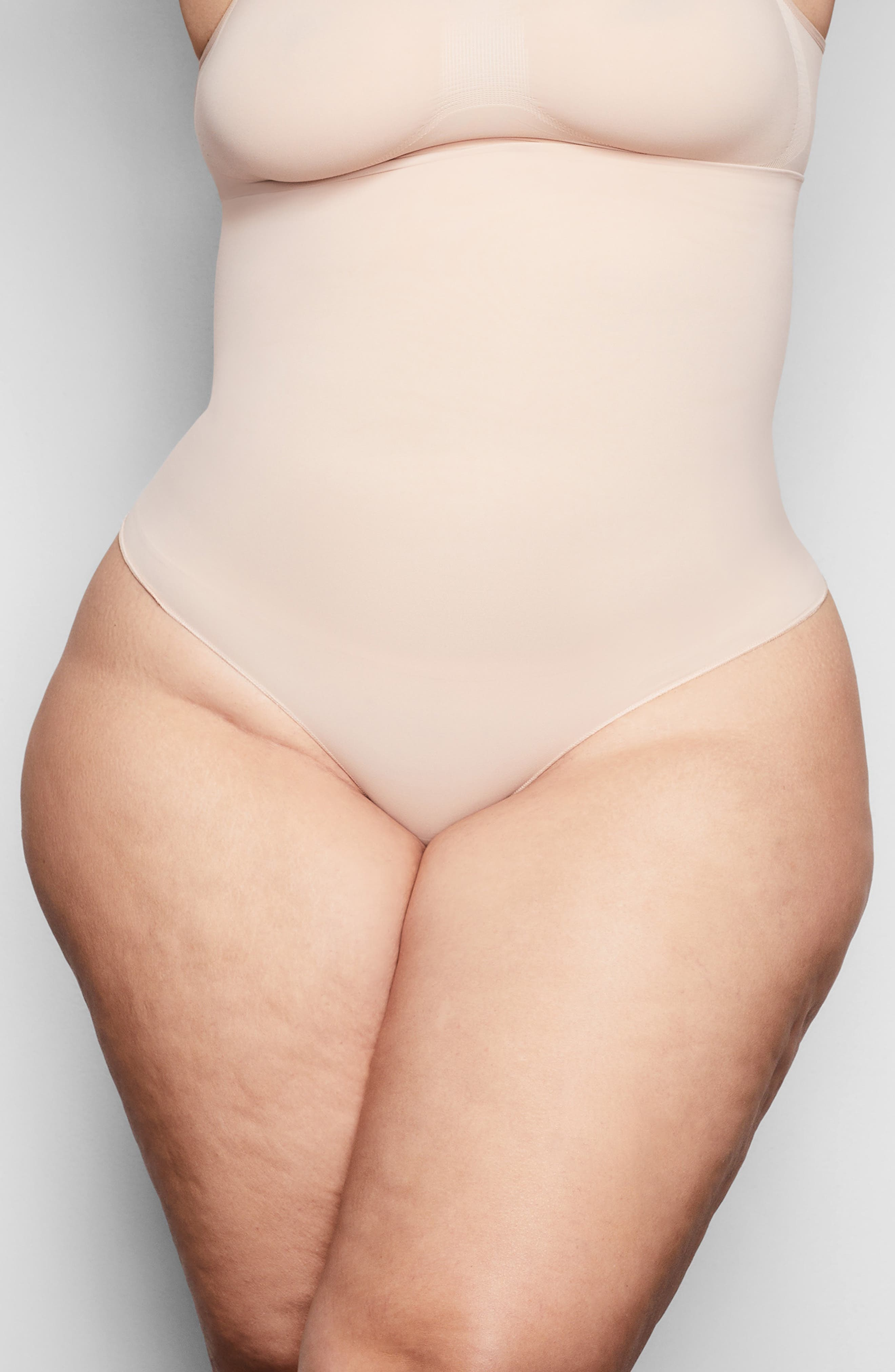 From Kim Kardashian West\\\'s SKIMS, this mid-rise thong that smoothes and tightly contours your core reflects the brand\\\'s passion for shapewear for every body. This everyday staple piece-with a supportive yet silky construction-enhances your body\\\'s natural shape and comes in nine different shades to complement your skintone. Style Name: Skims Core Control Thong (Regular & Plus Size). Style Number: 6016432. Available in stores.