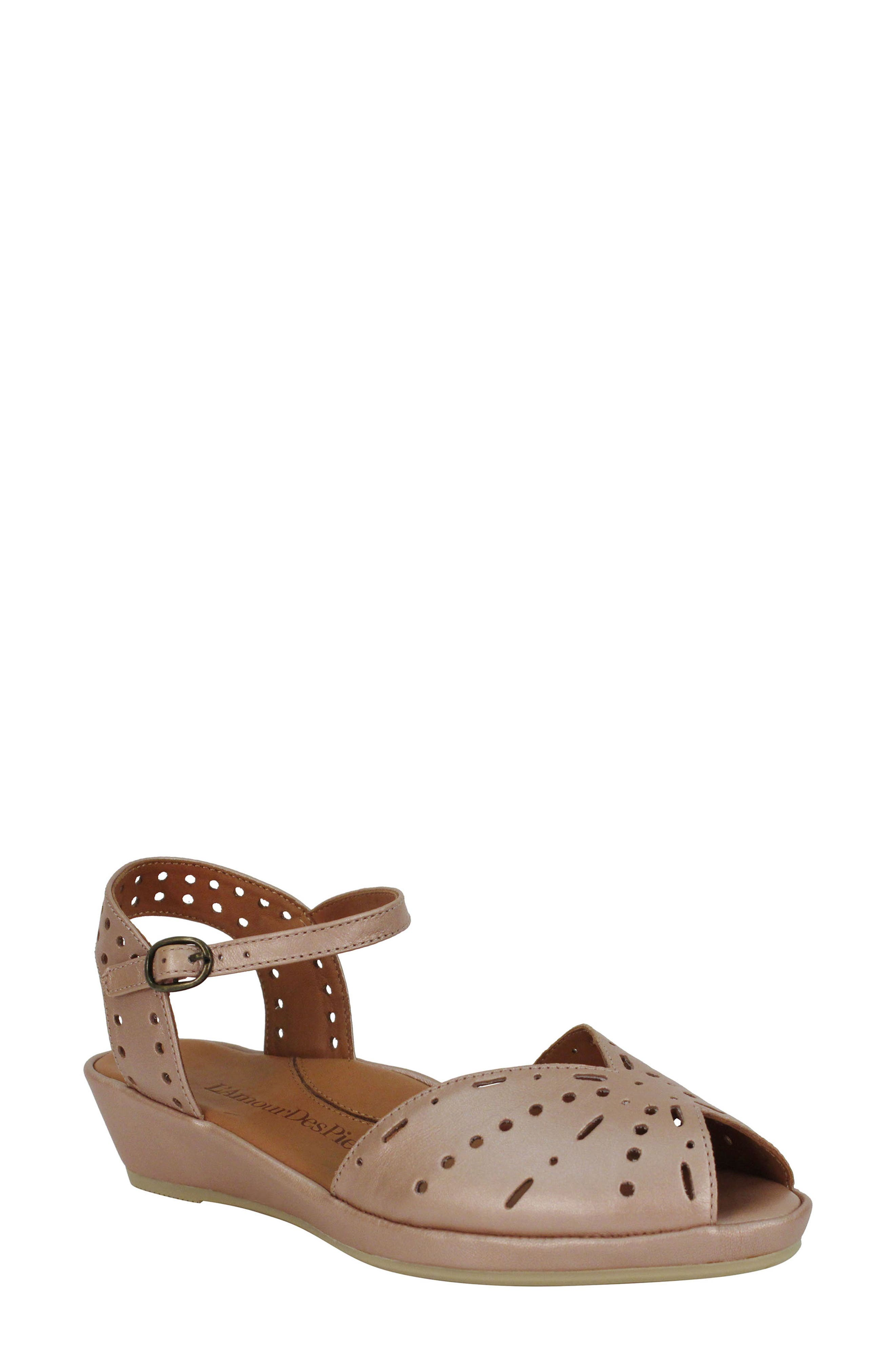 Suave cutouts and a slim ankle strap add eye-catching sophistication to a well-cushioned sandal set on a streamlined wedge. Style Name:L\\\'Amour Des Pieds \\\'Brenn\\\' Ankle Strap Sandal (Women). Style Number: 1136995 3. Available in stores.