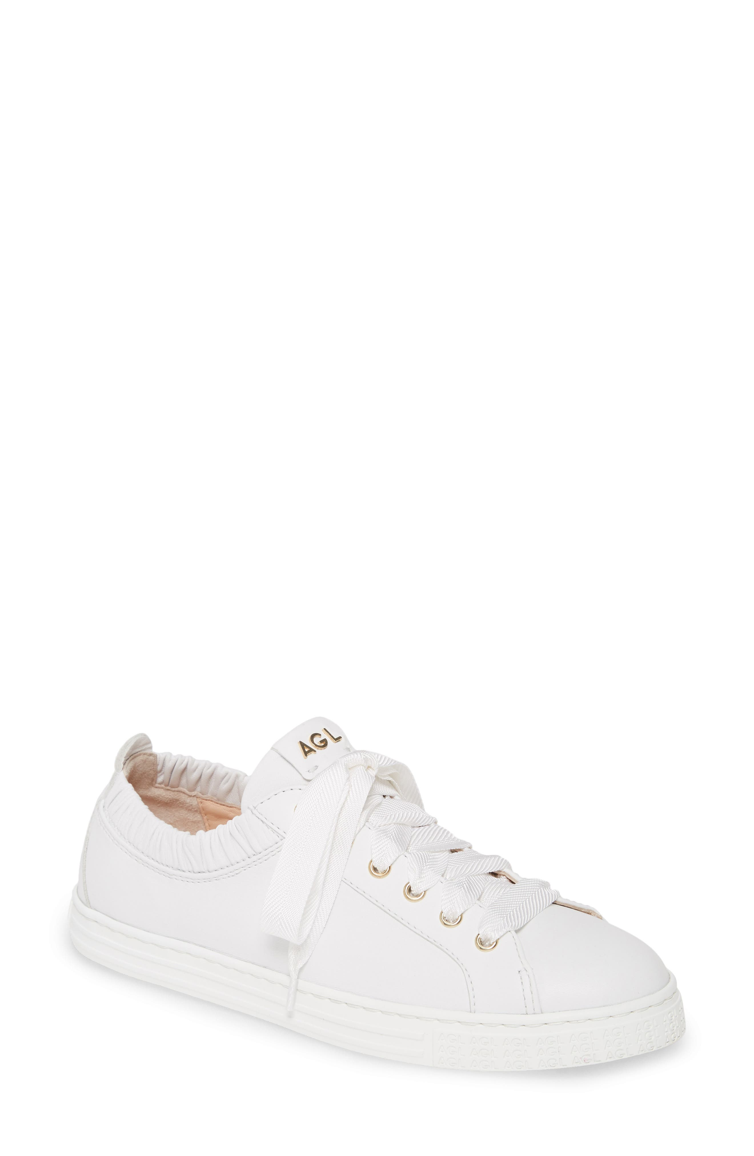 Grosgrain laces and a ruffled opening add to the feminine attitude of a supple leather sneaker grounded by a clean white cupsole. Style Name: Agl Ruffle Top Lace-Up Sneaker (Women). Style Number: 5957488. Available in stores.