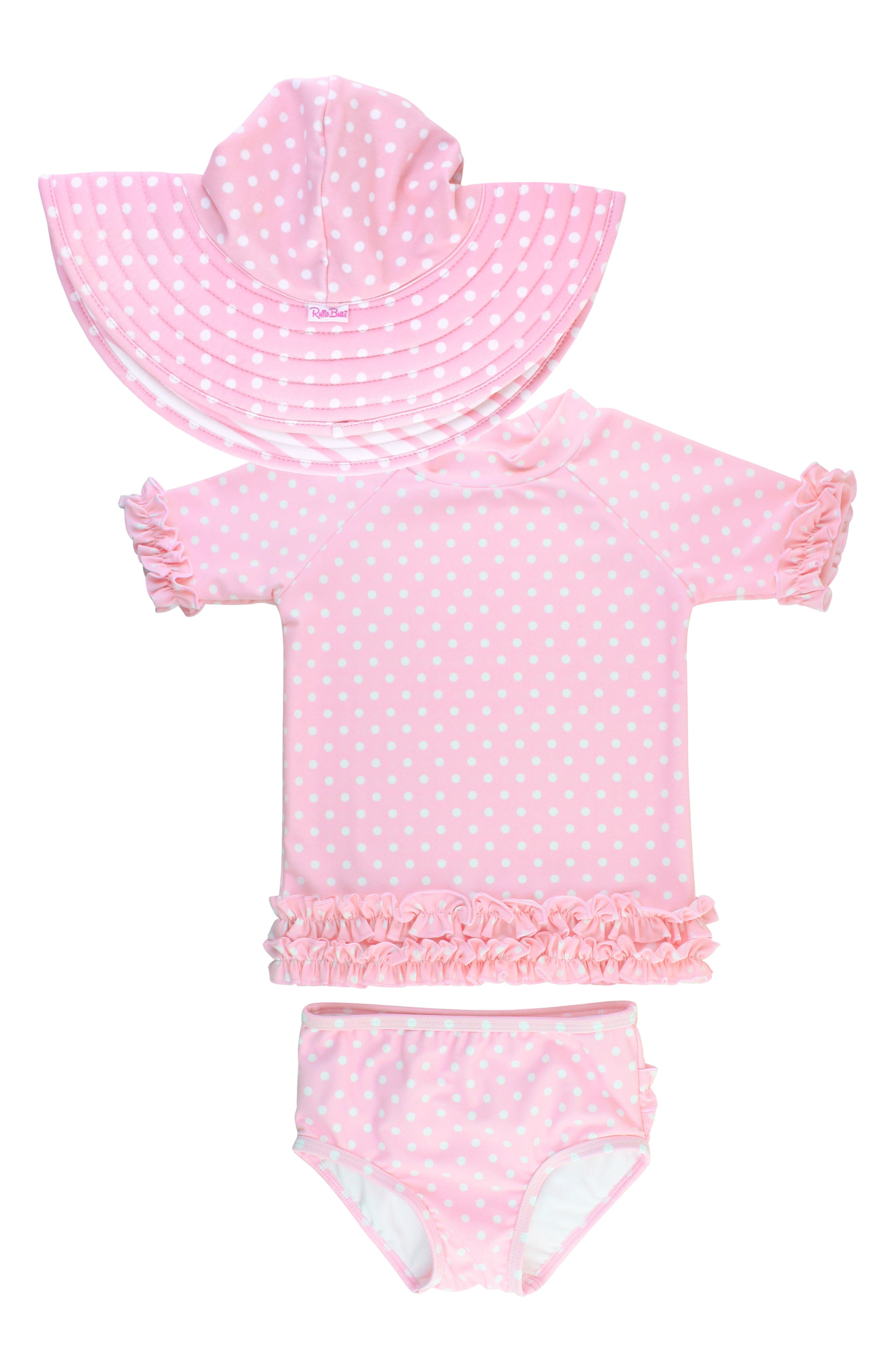 Give her a spot-on beach look with this matching polka dot swim ensemble with a ruffle-edged rashguard, ruffle-backed bottoms and a wide-brim hat. Style Name: Rufflebutts Polka Dot Two-Piece Rashguard & Hat Set (Toddler & Little Girl). Style Number: 6034898. Available in stores.