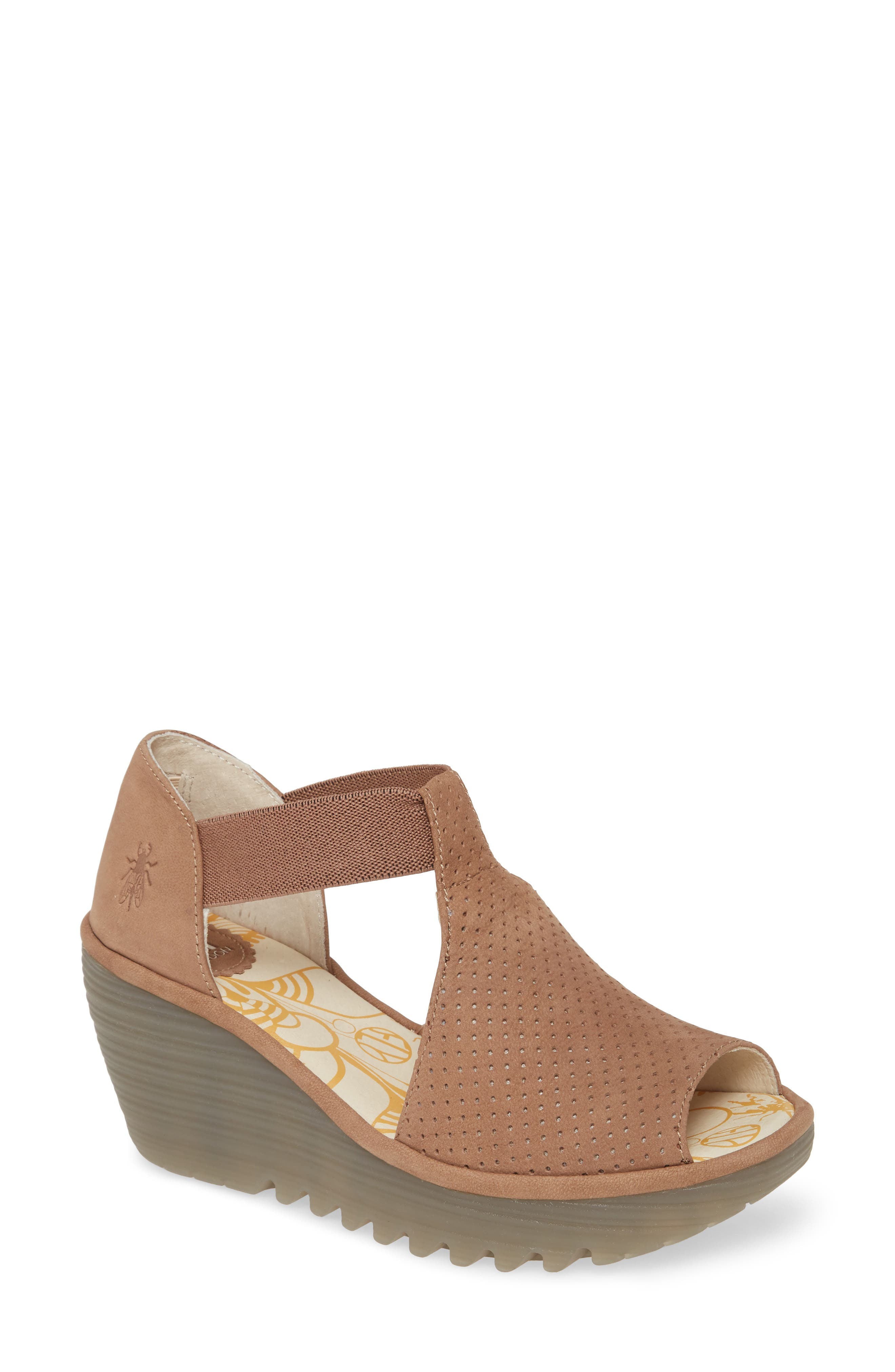 A signature textured wedge grounds a breezy peep-toe sandal that delivers the perfect combination of chic style and everyday comfort. Style Name: Fly London Yemo Sandal (Women). Style Number: 5960925 1. Available in stores.