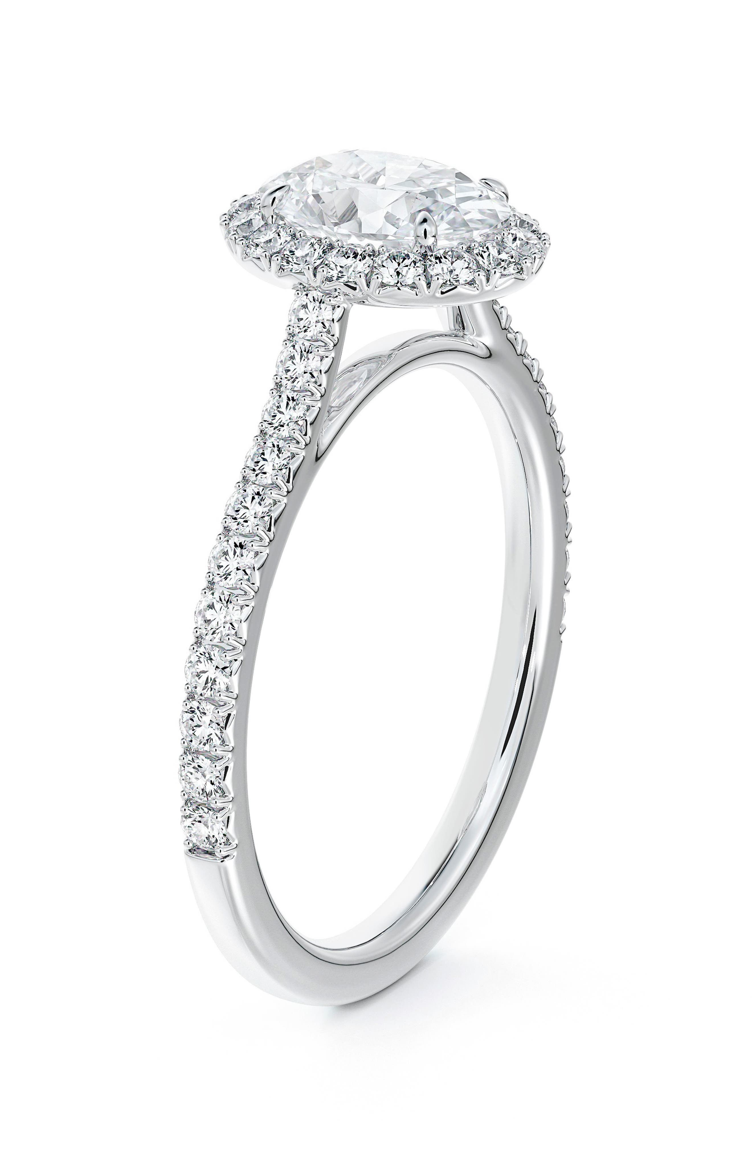 Center Of My Universe Oval Halo Engagement Ring With Diamond Band