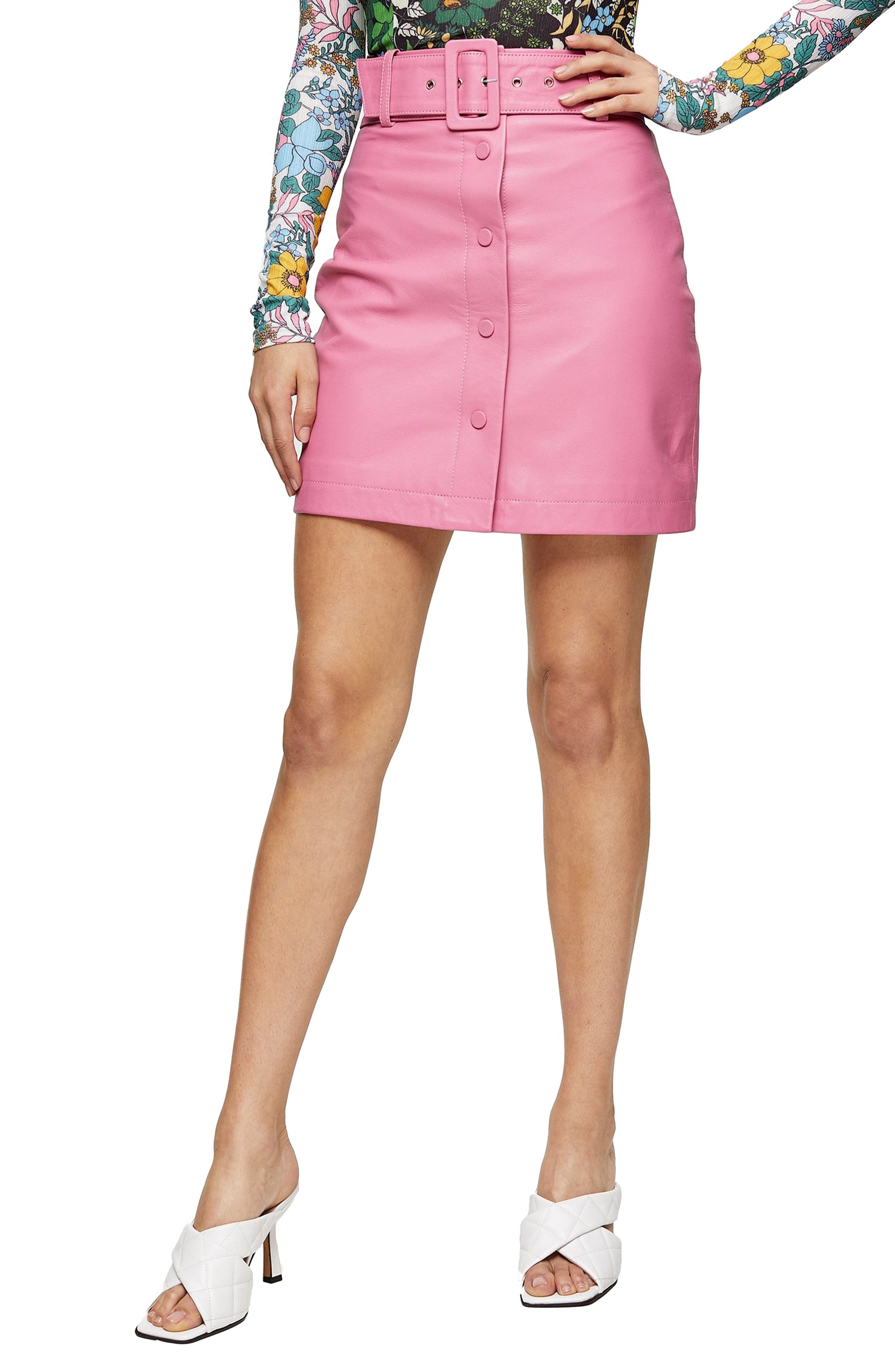 Sweeten your look in this pretty pink mini made from rich leather with a defining waist belt. Style Name: Topshop Belted Leather Miniskirt. Style Number: 6080802. Available in stores.