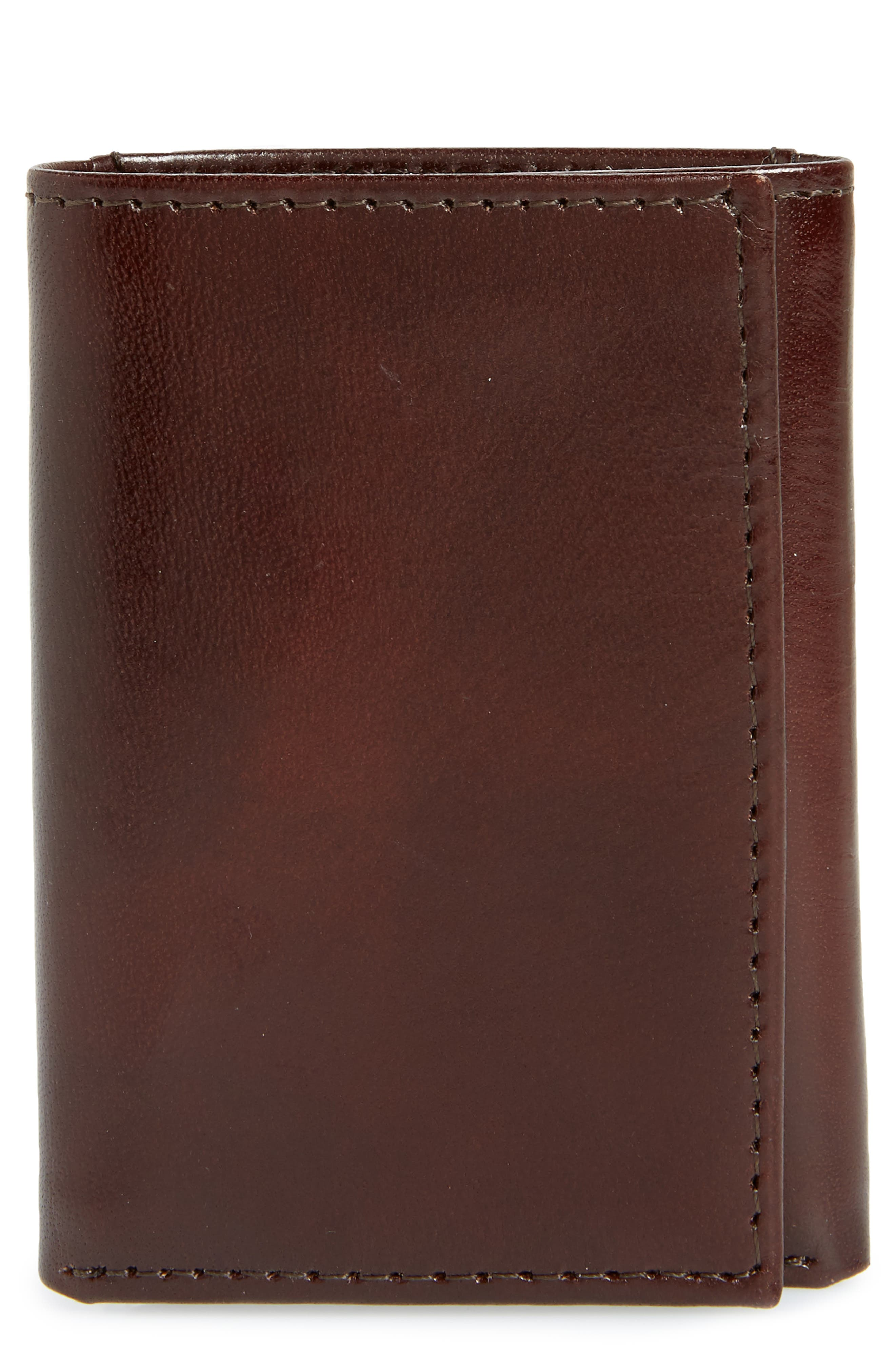 Fine leather defines a smart, trifold wallet featuring a well-organized interior for utility and style. Style Name: Johnston & Murphy Leather Wallet. Style Number: 5338411. Available in stores.