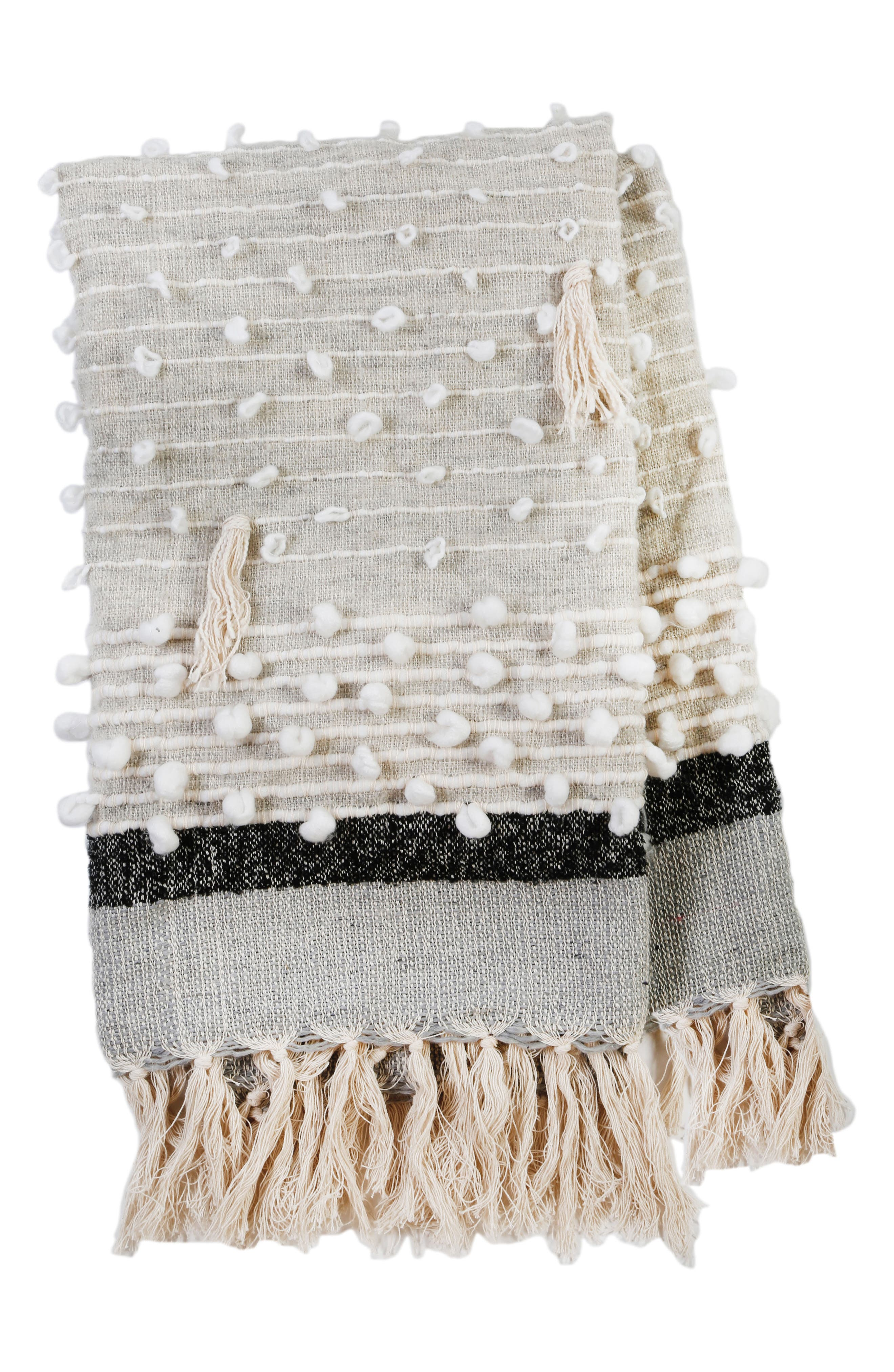 Soft tassel trim enhances the boho styling of a cozy throw handwoven from a soft blend of fabrics that add instant texture to your favorite space. Style Name: Pom Pom At Home Ziggy Woven Throw Blanket. Style Number: 5629251. Available in stores.