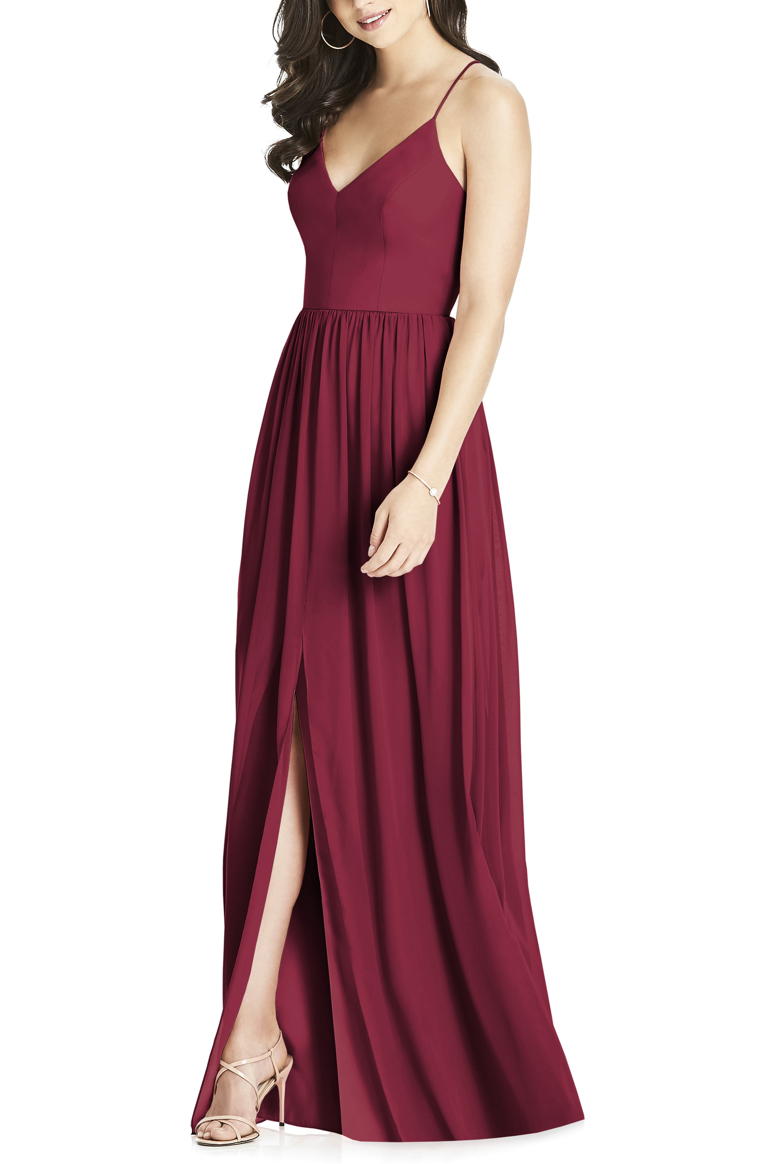 This elegant gown is crafted from flowing chiffon that drapes eloquently down the pleated skirt and features an open back crisscrossed by spaghetti straps. A front slit enhances graceful movement and flashes a lovely length of leg. Style Name: Dessy Collection Spaghetti Strap Chiffon A-Line Gown. Style Number: 5520458. Available in stores.