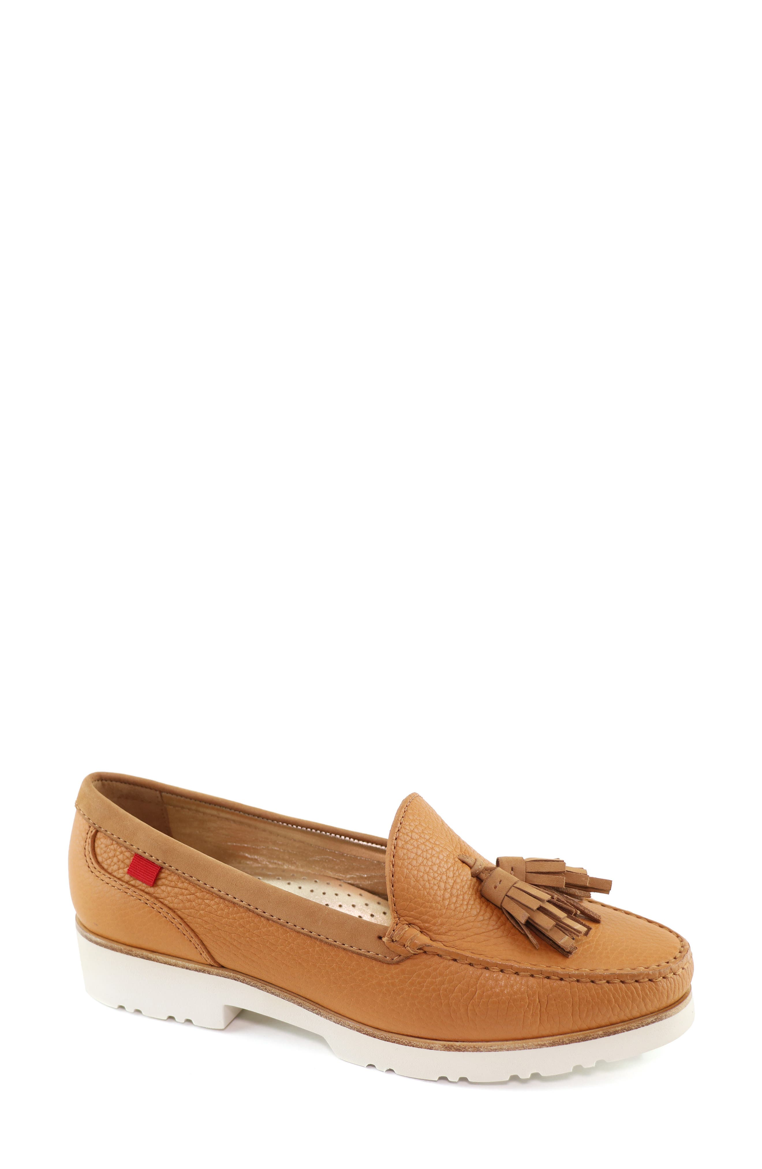 A lugged platform sole adds a modern twist to a well-cushioned loafer topped with dual tassels. Style Name: Marc Joseph New York New Brighton Platform Loafer (Women). Style Number: 5977817. Available in stores.