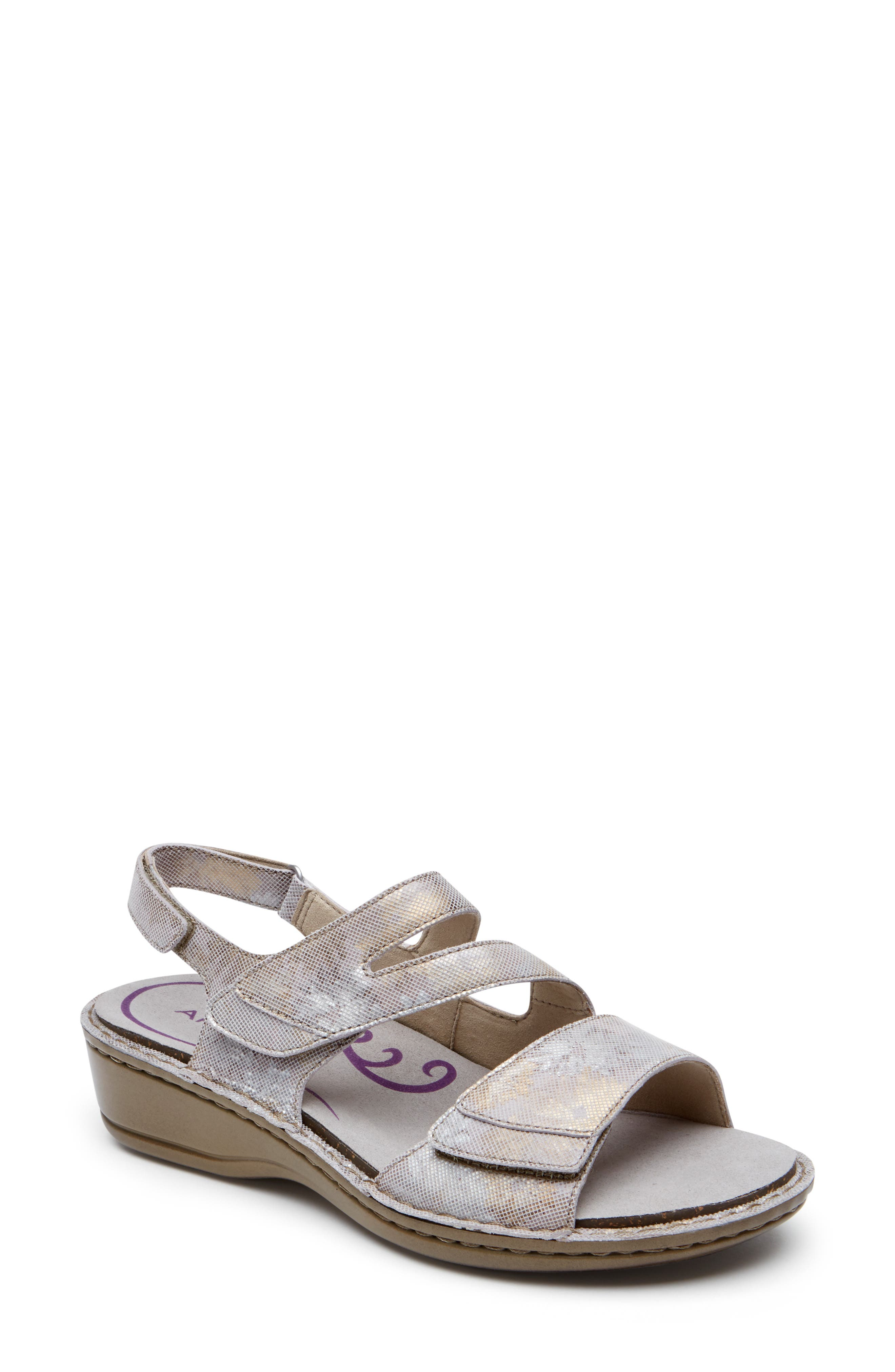 Breezy style and all-day comfort go hand-in-hand on this chic slingback sandal designed with adjustable straps and a memory-foam cushioned footbed. Style Name: Aravon Cambridge Slingback Sandal (Women). Style Number: 5815868. Available in stores.