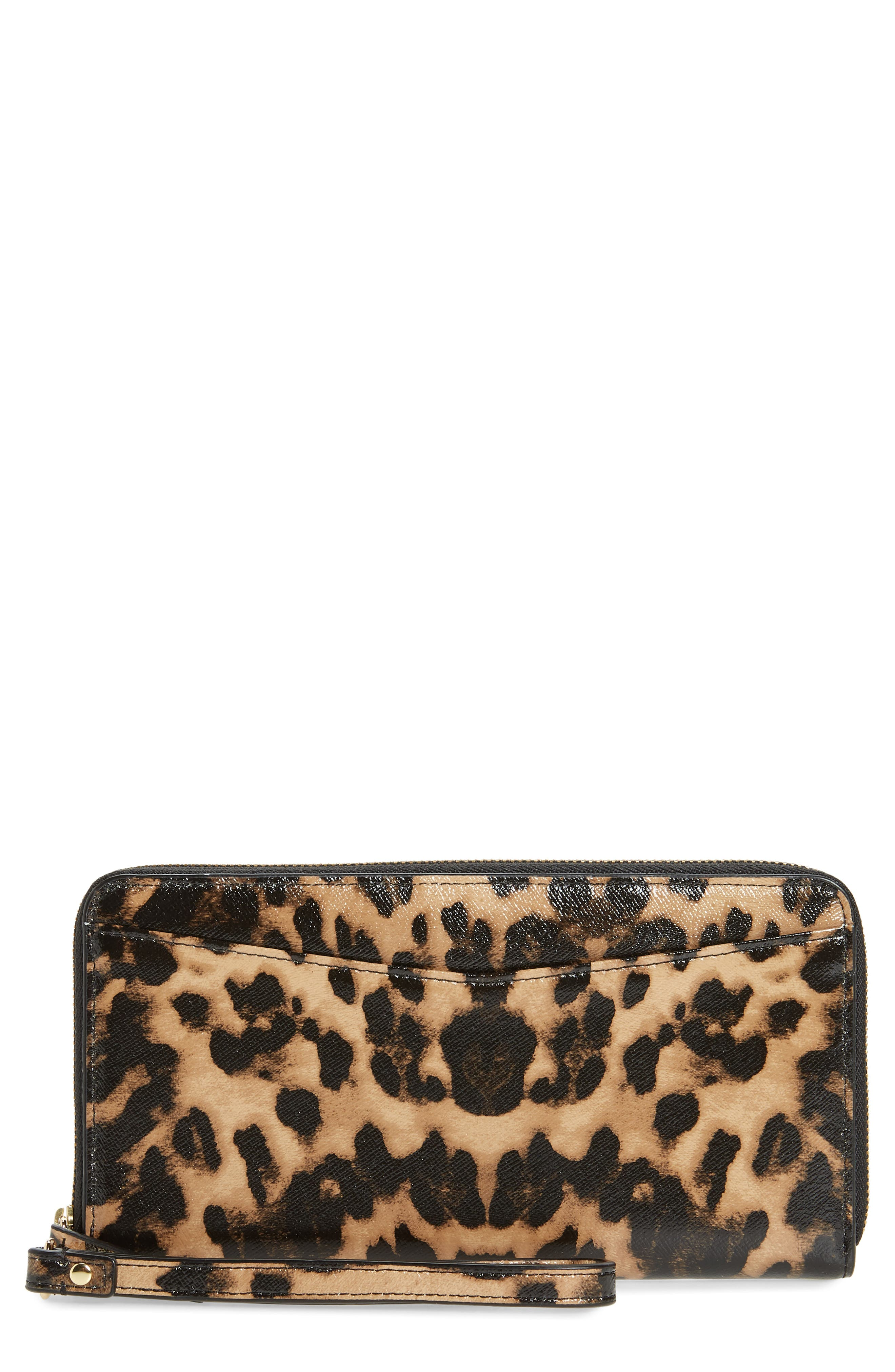 A wrist strap offers clutch styling on this zip-around leather wallet with a luxe animal pattern. Style Name: Nordstrom Leather Continental Wallet. Style Number: 5960088. Available in stores.
