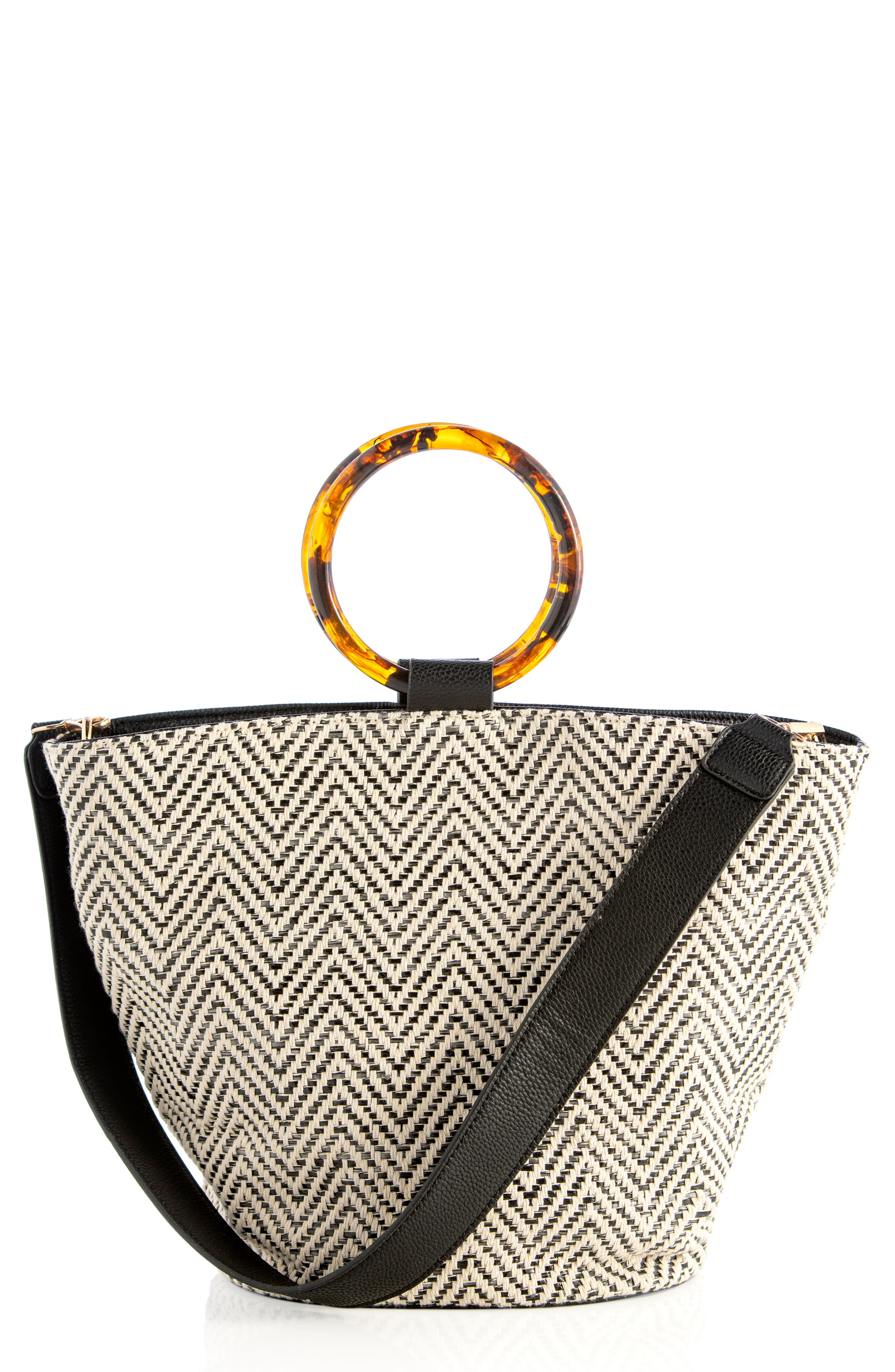 Glossy ring handles and a removable shoulder strap bring styling versatility to a spacious tote featuring a striking two-tone weave. Style Name: Shiraleah Arbelle Ring Handle Woven Tote. Style Number: 6026060. Available in stores.