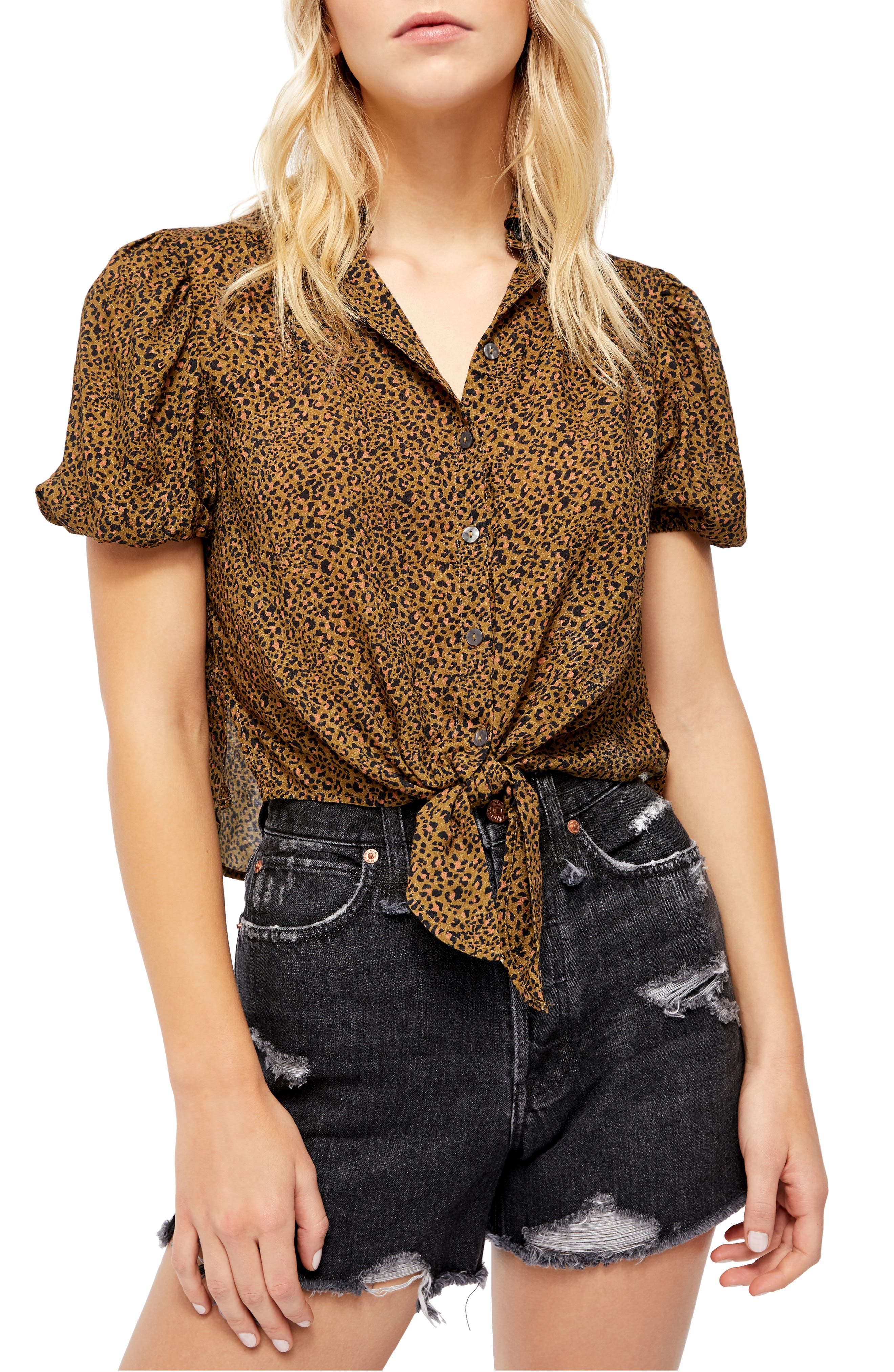 An exotic print enlivens a button-front blouse finished with adjustable ties at the hem. Style Name: Free People Celia Animal Print Blouse. Style Number: 6047234. Available in stores.