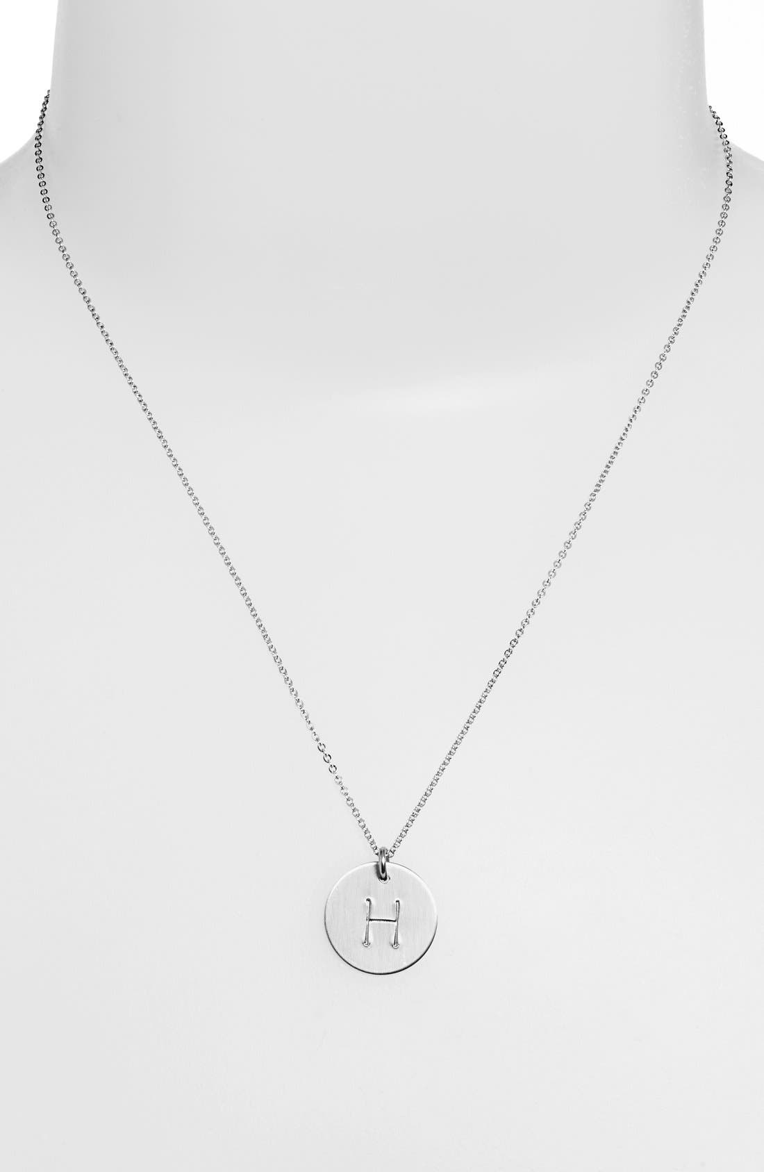 From humble beginnings to a fully staffed warehouse in Bend, Oregon, Nashelle remains true to its original purpose-handmade jewelry crafted with love and intention. A hand-stamped initial is centered on a gorgeous sterling silver disc attached to a chain-link necklace. Style Name: Nashelle Sterling Silver Initial Disc Necklace. Style Number: 813134. Available in stores.
