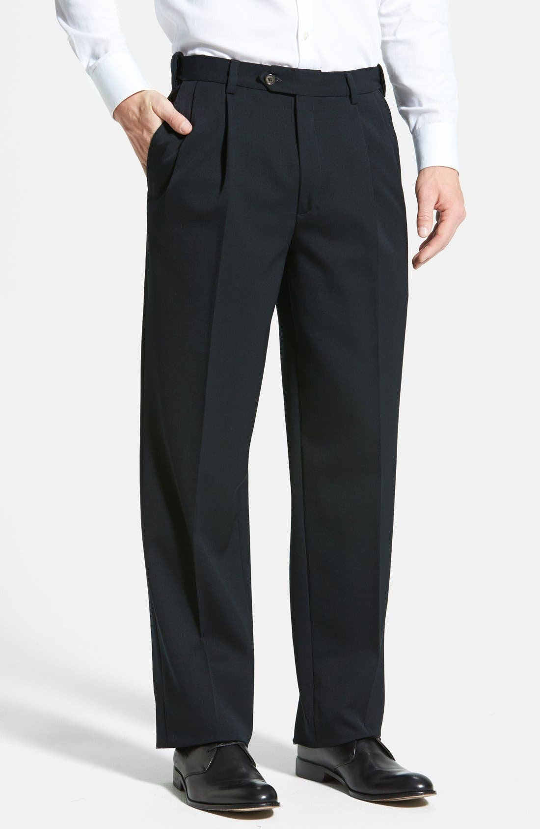 A classic pleated cut styles sharp cuffed trousers fashioned from finely textured wool gabardine and fitted with a self-sizer waistband to ensure a custom fit. Style Name: Berle Self Sizer Waist Pleated Classic Fit Wool Gabardine Dress Pants. Style Number: 461449. Available in stores.