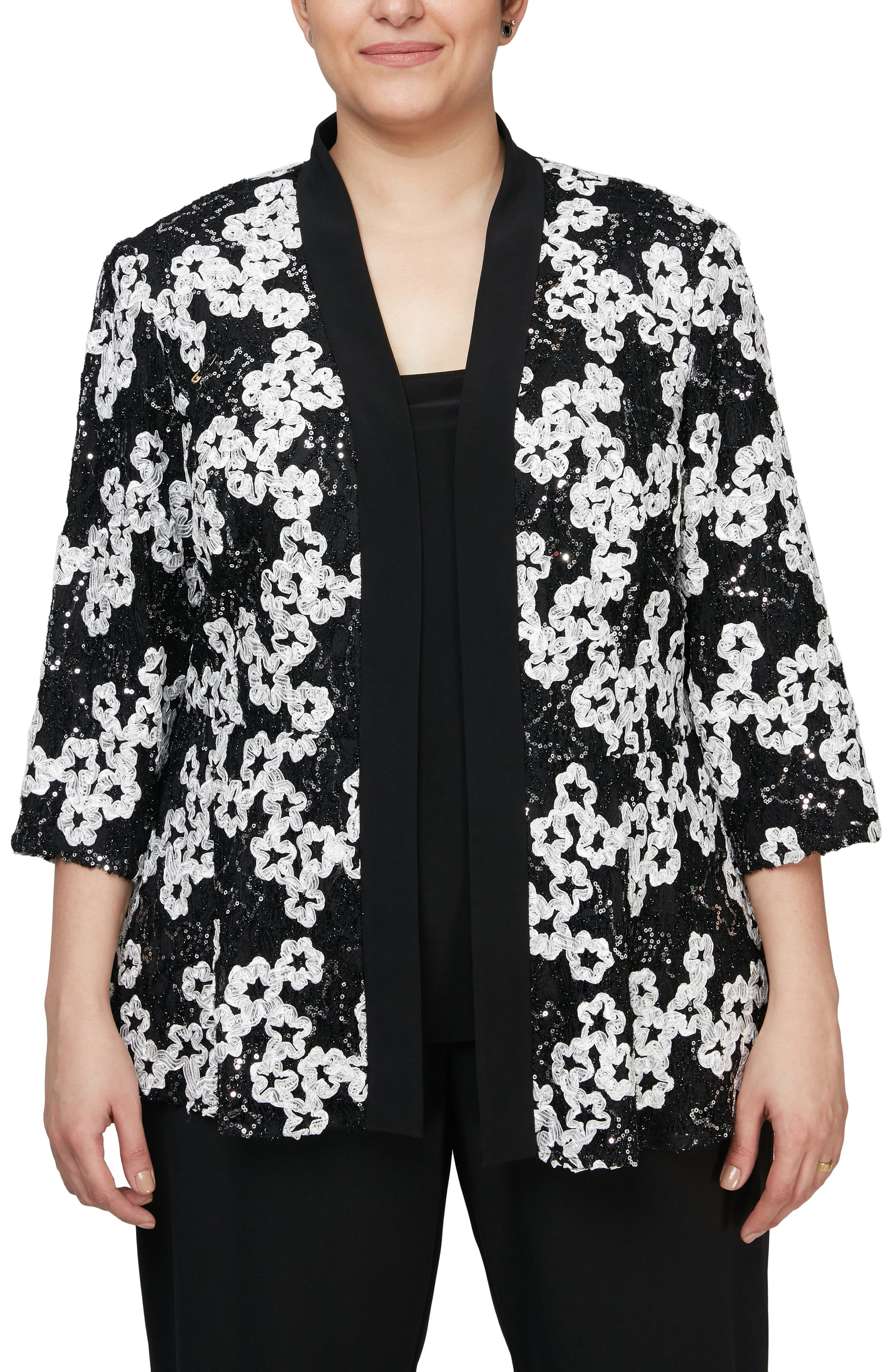 Pairing a scoop-neck tank with a three-quarter-sleeve jacket adorned by sequins and ribbons of blooms, this duo is an elegant way to layer at your next event. Style Name: Alex Evenings Floral & Sequin Applique Jacket & Tank Set (Plus Size). Style Number: 6102726. Available in stores.