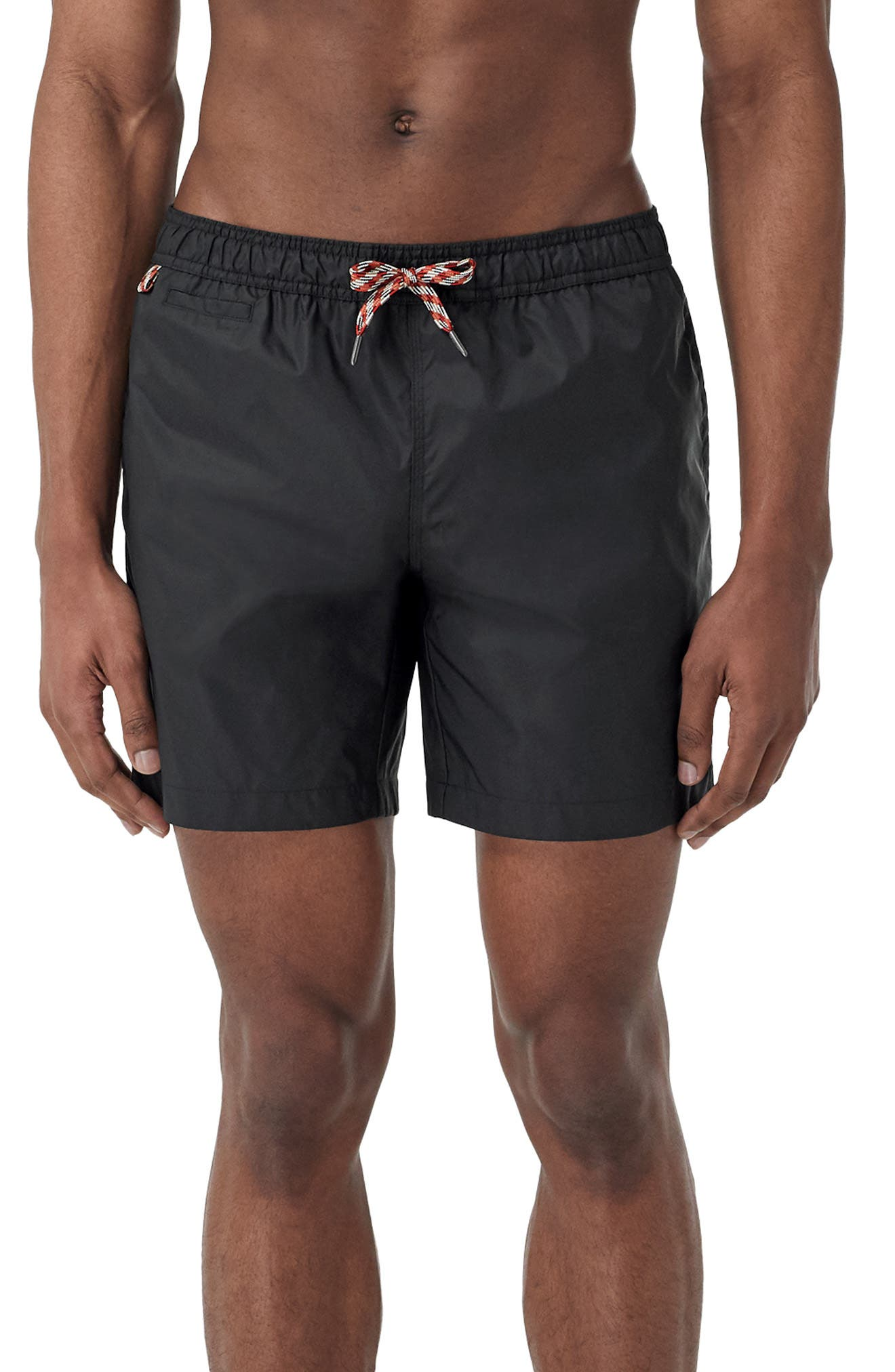 Quick-drying black swim trunks keep you supported and comfortable in or out of the water with a breathable mesh-brief lining. Style Name: Burberry Martin Swim Trunks. Style Number: 6016505. Available in stores.