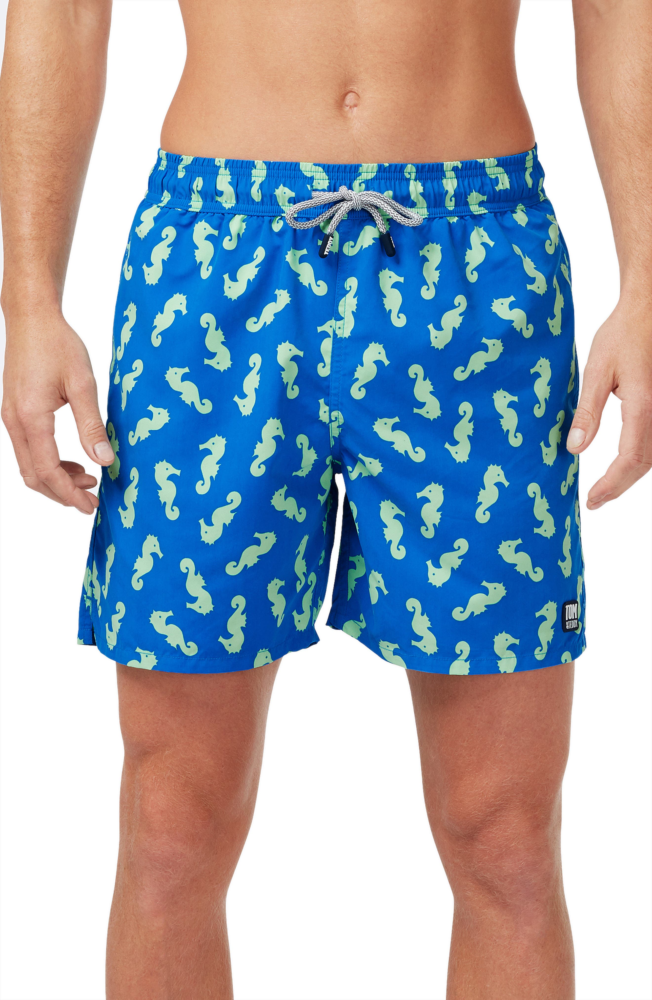 Seahorses dance across light quick-dry swim trunks that are UV-blocking and resistant to fading from salt and chlorine. Style Name: Tom & Teddy Seahorse Print Swim Trunks. Style Number: 6013733. Available in stores.