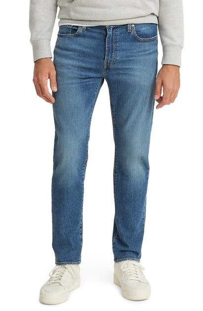 Levi's 502(TM) REGULAR TAPERED LEG FLEX JEANS