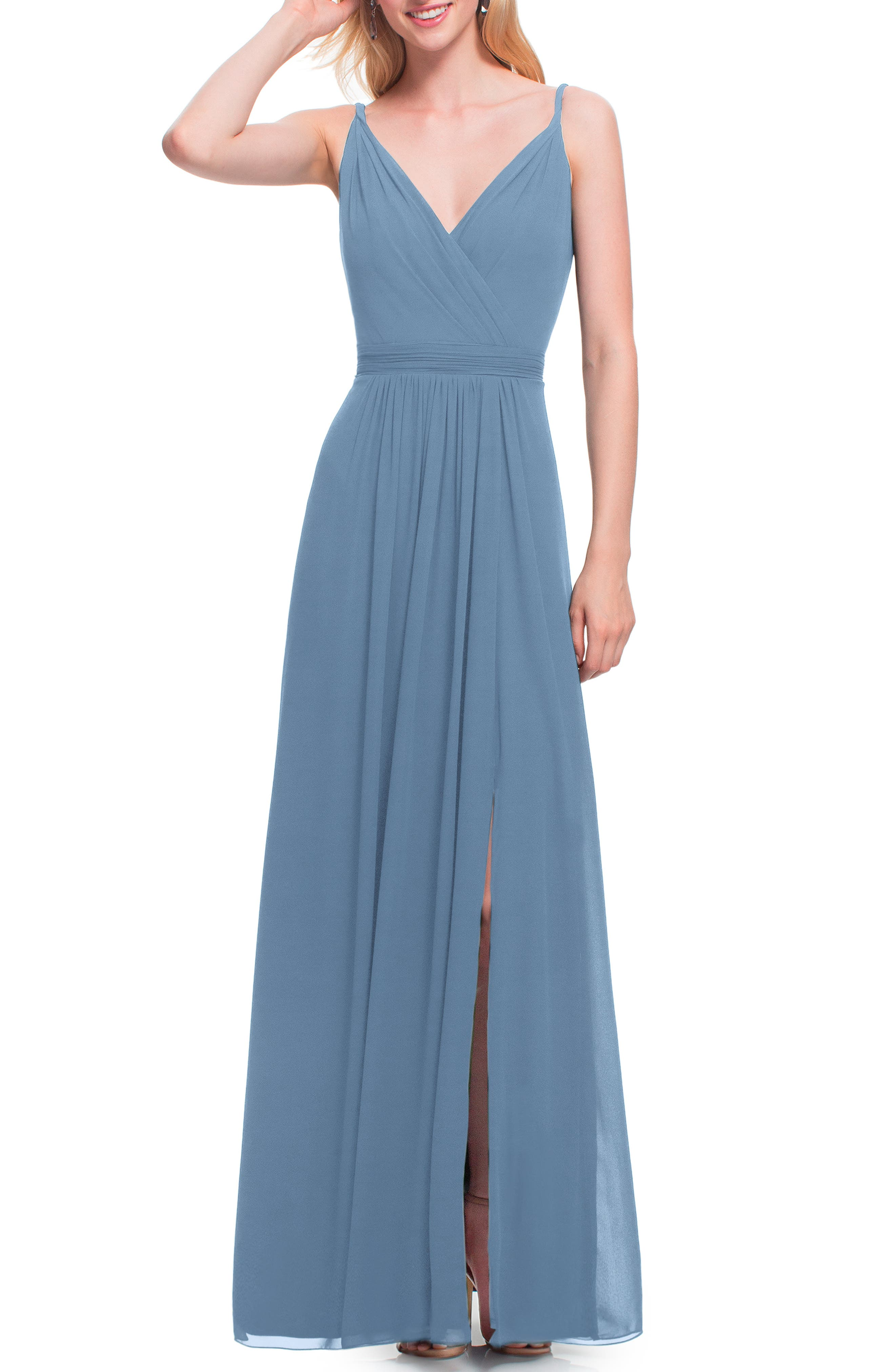 The picture of romantic elegance, this gently gathered chiffon gown features a surplice neckline that compliments the open V-back. Attractive ruching defines your waist and the flattering A-line skirt flows dreamily to the floor. Style Name:#levkoff Surplice Neck Chiffon A-Line Gown. Style Number: 5533345. Available in stores.