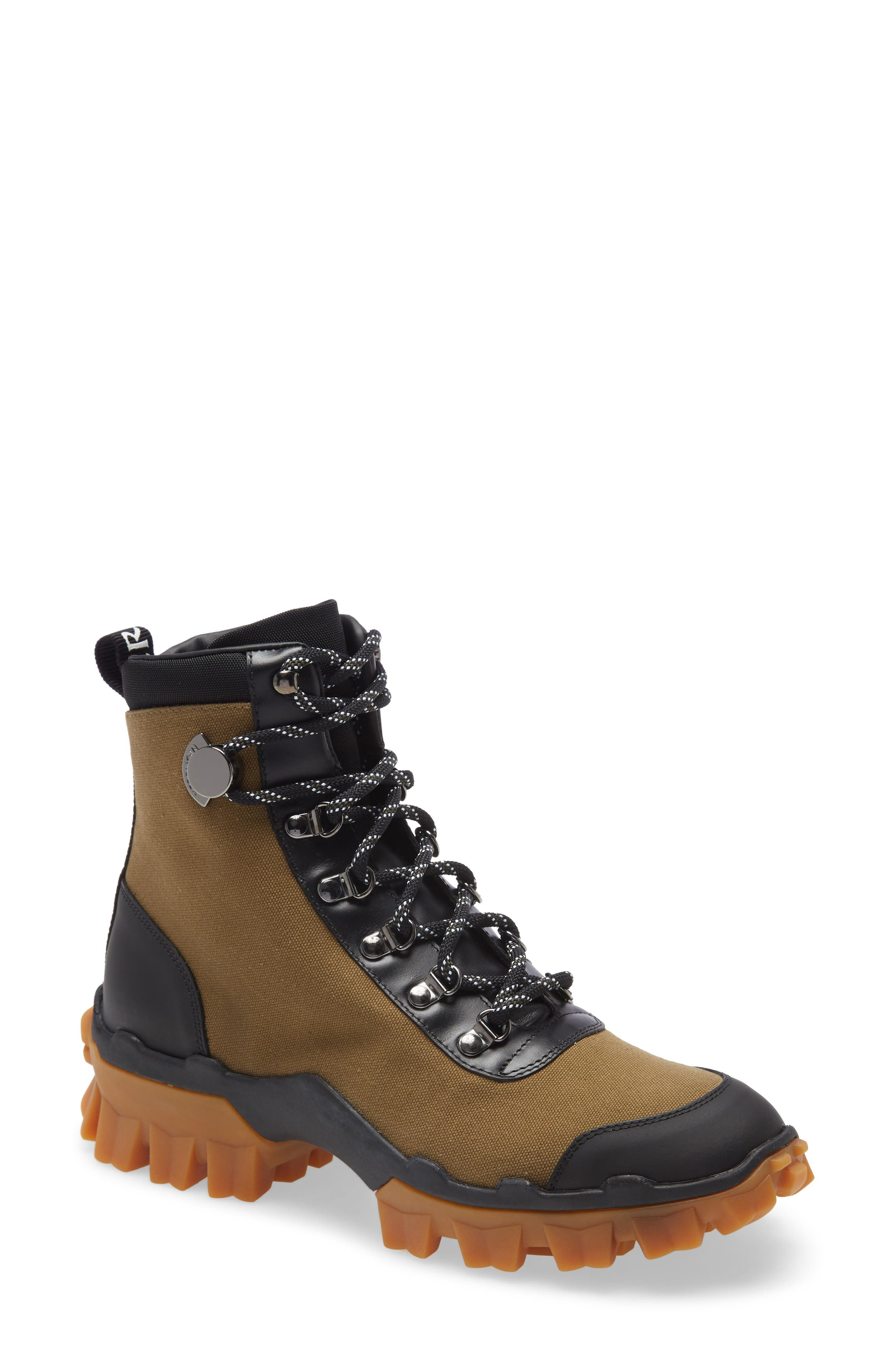 A mountain-crushing sole and logo-printed pull tab steer this boot in a fashion-forward direction while metal eyelets and sturdy laces keep the look classic. Style Name: Moncler Helis Hiking Boot (Women). Style Number: 5971662. Available in stores.