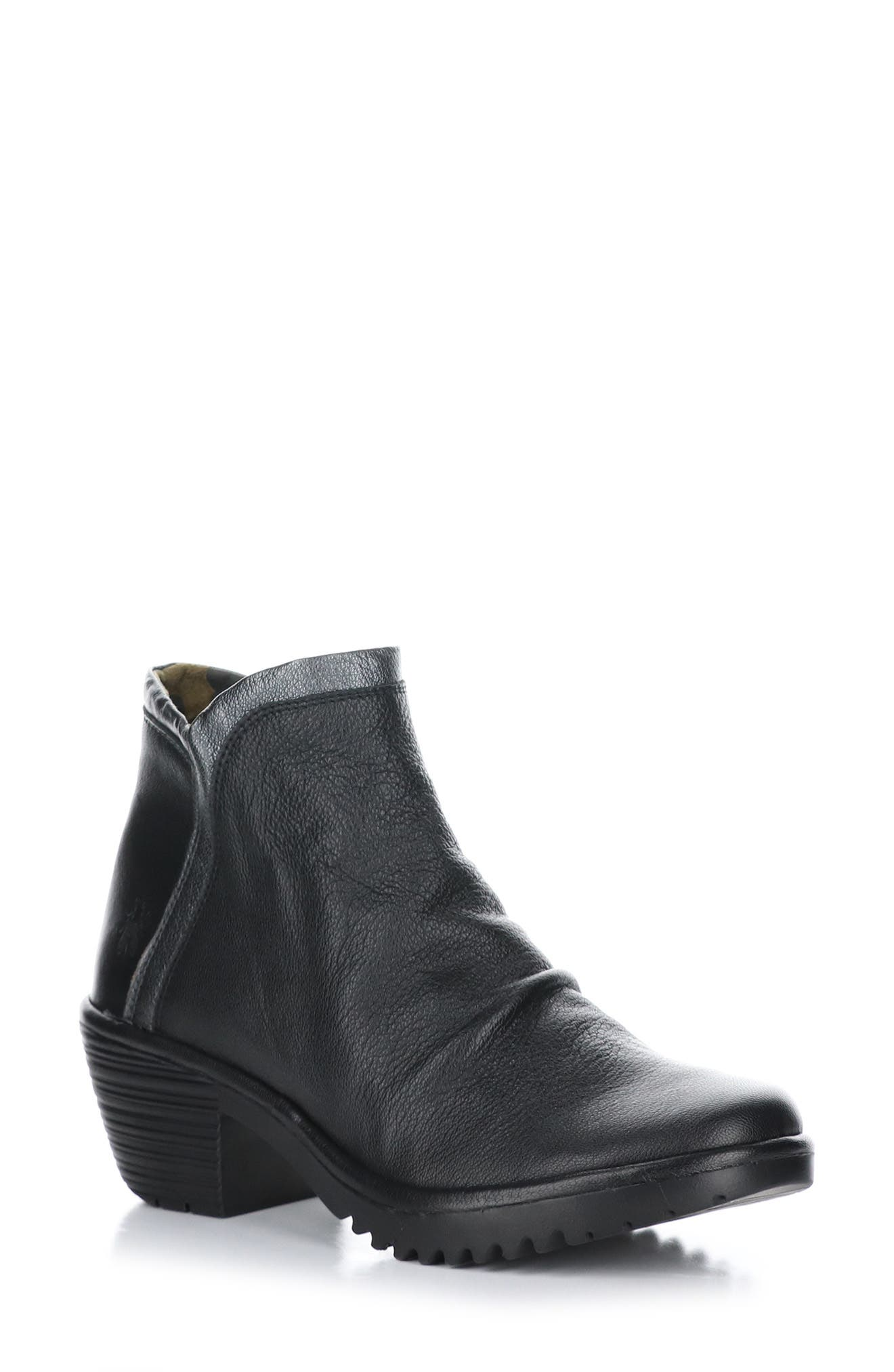 This water-resistant boot with gleaming trim will keep you comfortable with a cushioned insole and breathable leather. Style Name: Fly London Wynn Bootie (Women). Style Number: 6094334. Available in stores.