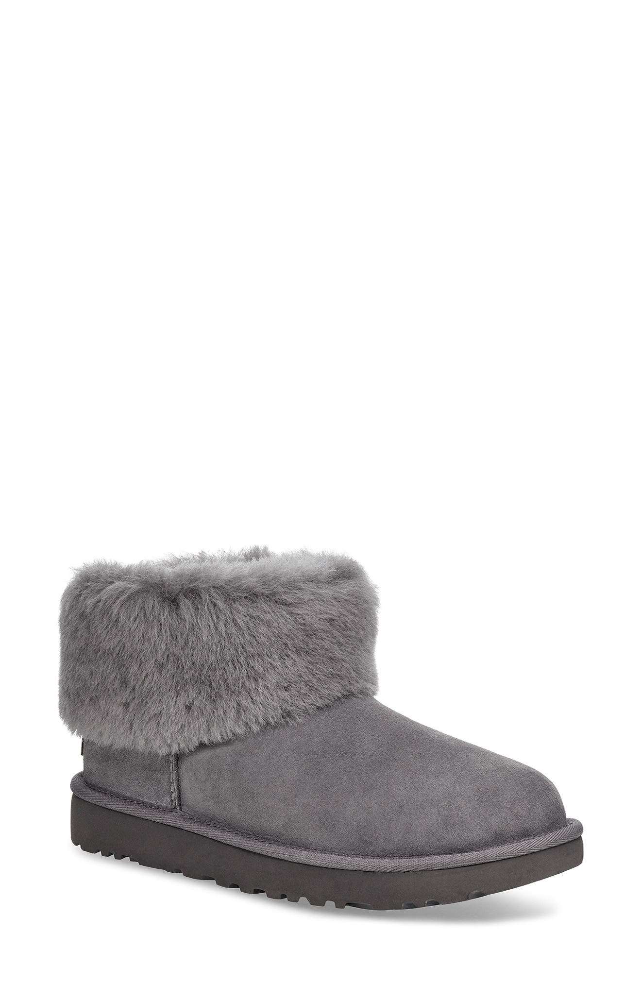A plush, short shaft of fluffy genuine shearling on a cozy boot-a fan-favorite updated with a modern look. Style Name: UGG Classic Mini Fluff Genuine Shearling Bootie (Women). Style Number: 5874054. Available in stores.