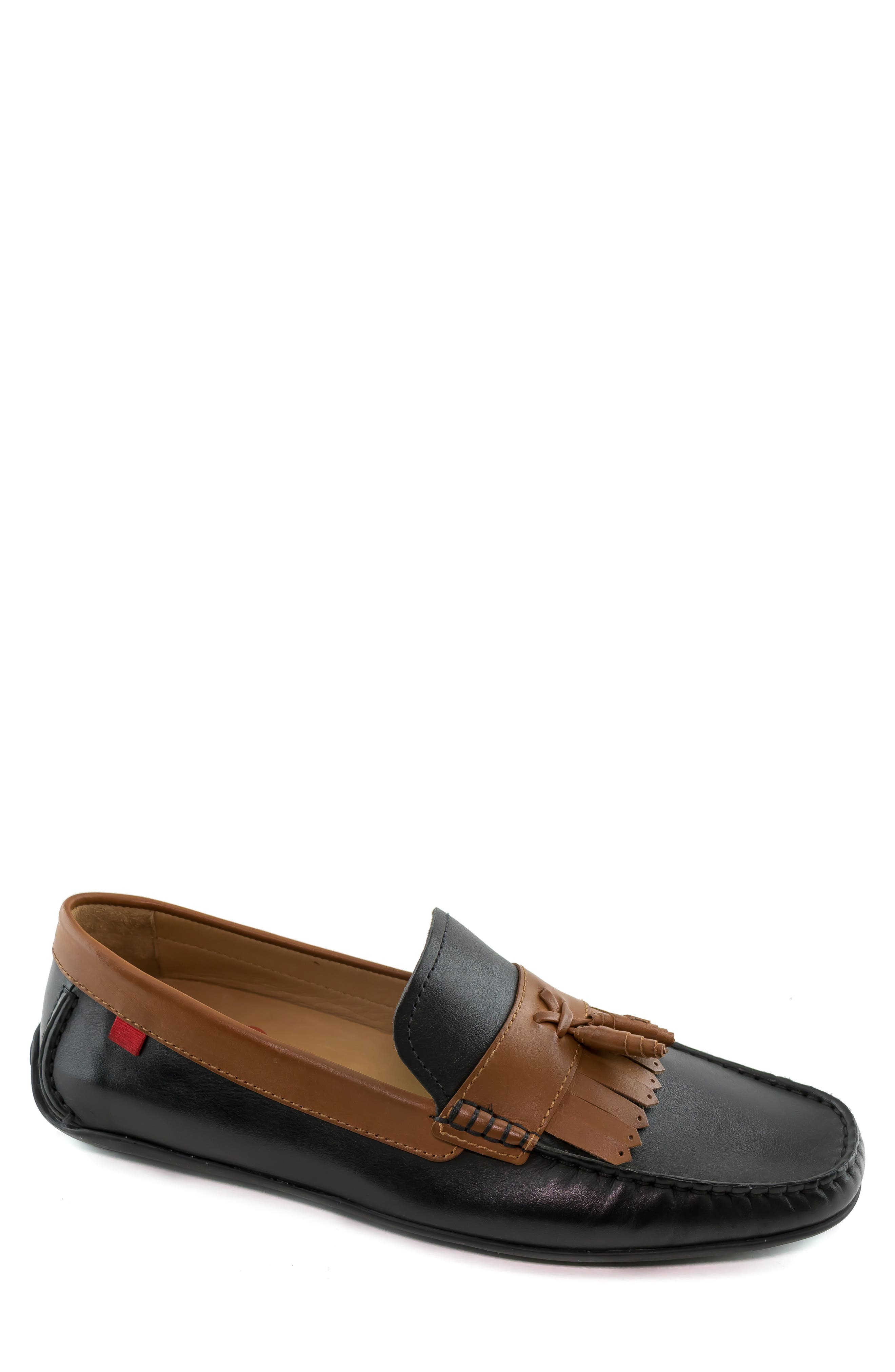 Handsome contrast trim tops a versatile driving shoe set on a durable, flexible sole that provides reliable traction. The footbed is padded and includes a gel heel insert for all-day support. Style Name: Marc Joseph New York Liberty Driving Shoe (Men). Style Number: 6034678 1. Available in stores.