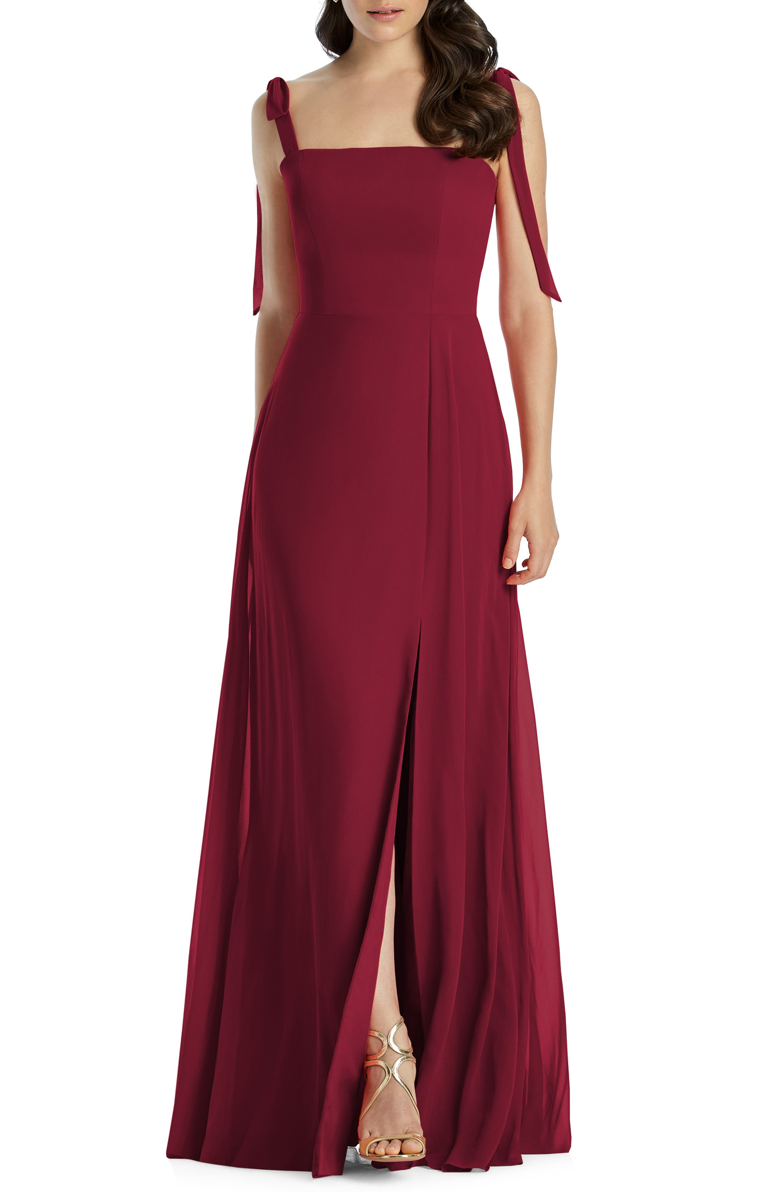 Drapey ties at the shoulders and a flowing chiffon skirt softly balance the square-cut bodice on this classic gown, with a front slit adding a touch of allure. Style Name: Dessy Collection Shoulder Tie Chiffon A-Line Gown. Style Number: 5793219 1. Available in stores.