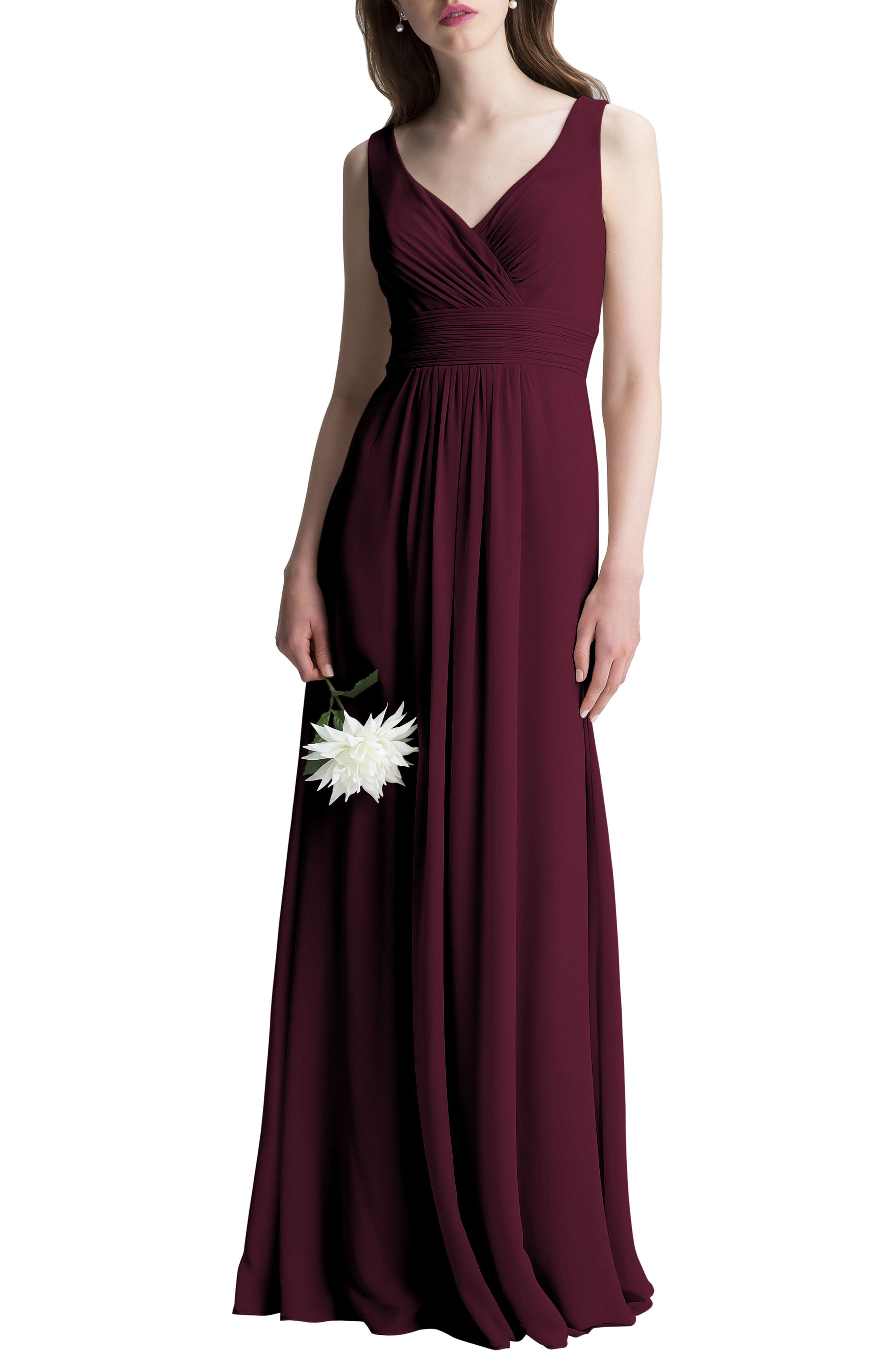 This dreamy chiffon gown is incredibly flattering from all angles thanks to its softly gathered surplice neckline, plunging V-back and ruched waist. The gathered A-line skirt flows to the floor for a romantic finish. Style Name:#levkoff V-Neck Chiffon A-Line Gown. Style Number: 5342446 1. Available in stores.