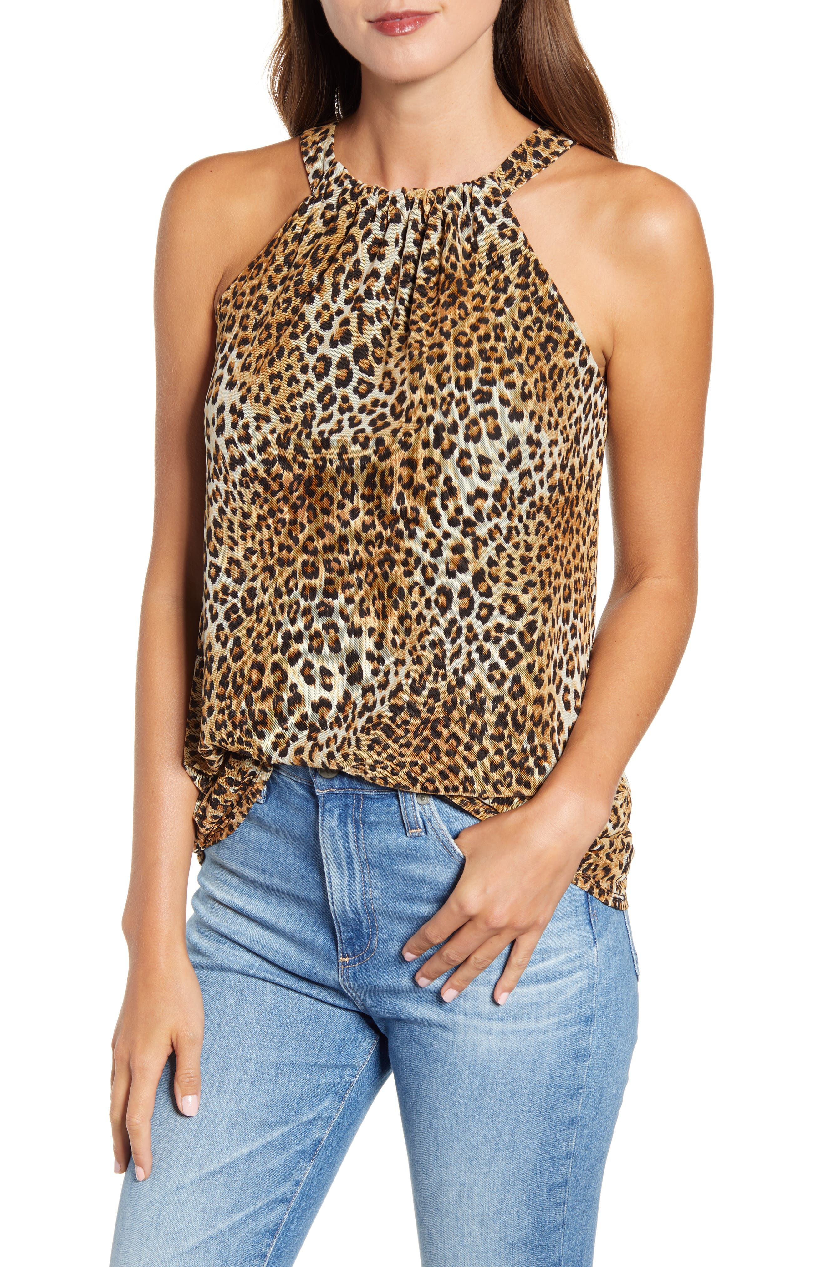 Enliven any look with the slinky leopard spots of this stretch-mesh tank gathered to a halter-style neckline that cuts away to show glowing shoulders. Style Name: Loveappella Leopard Print Mesh Tank. Style Number: 5921392. Available in stores.