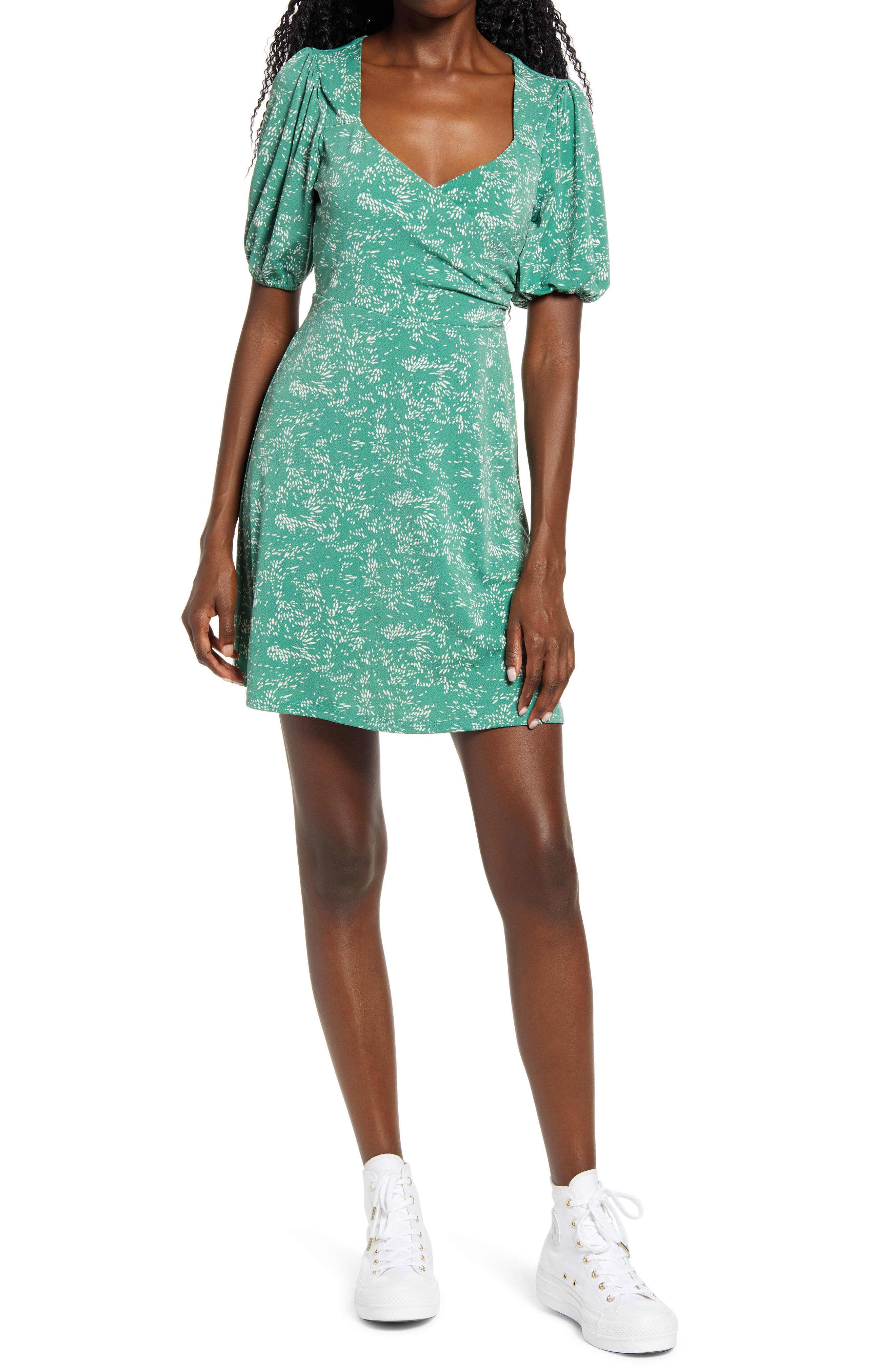 A sweet print enlivens this pretty, puff-sleeve frock styled with a cross-front bodice and a swingy skirt. Style Name: All In Favor Surplice Minidress. Style Number: 6032181. Available in stores.