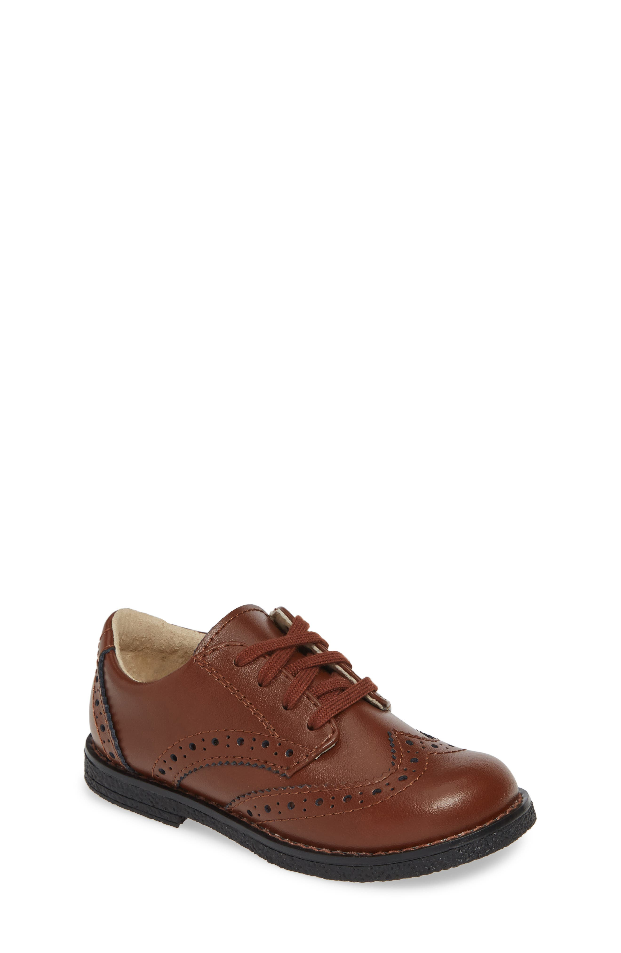 A burnished leather oxford with classic broguing features a cushioned insole that will keep him comfortable with every step he takes. Style Name: Footmates Logan Oxford (Walker, Toddler & Little Kid). Style Number: 5793584. Available in stores.