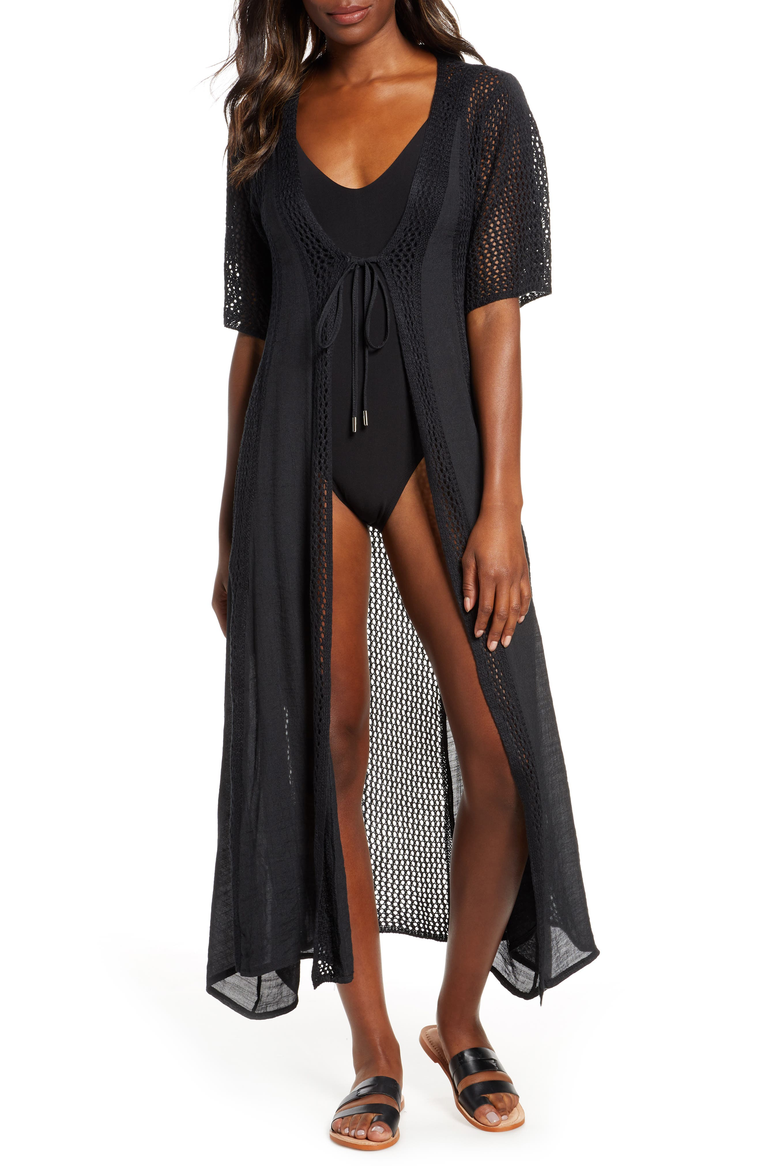 Panels of open crochet work add to the airy look and feel of a woven cover-up in a long cut with a tie front. Style Name: Elan Crochet Panel Swim Cover-Up. Style Number: 5848289. Available in stores.