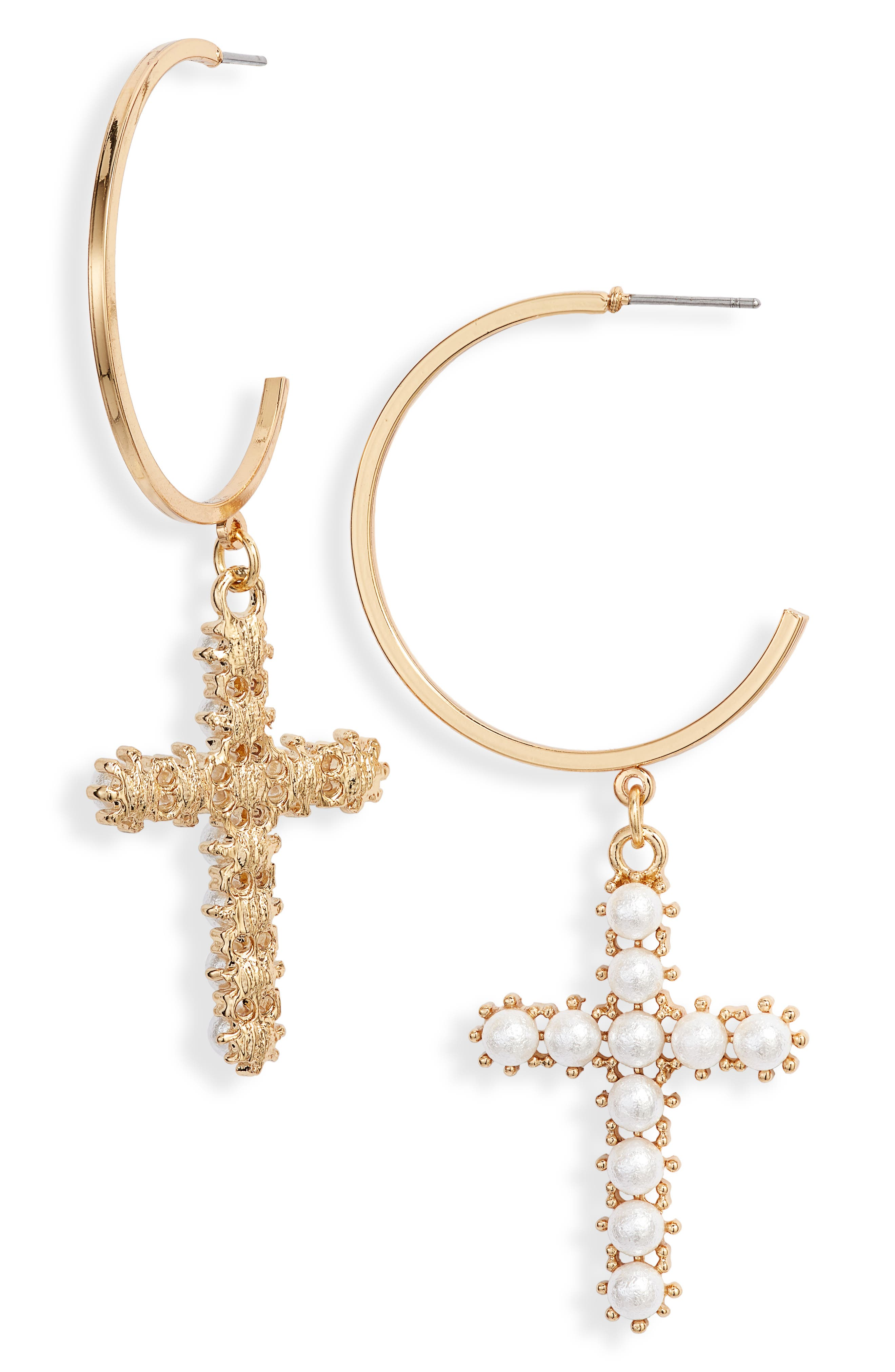 Fashion-forward symbols of faith, these earrings feature imitation-pearl cross pendants suspended from open hoops, all cast in gleaming 18-karat-gold plate for an elegant and ecclesiastical style. Style Name: Ettika Imitation Pearl Cross & Hoop Earrings. Style Number: 5668018. Available in stores.