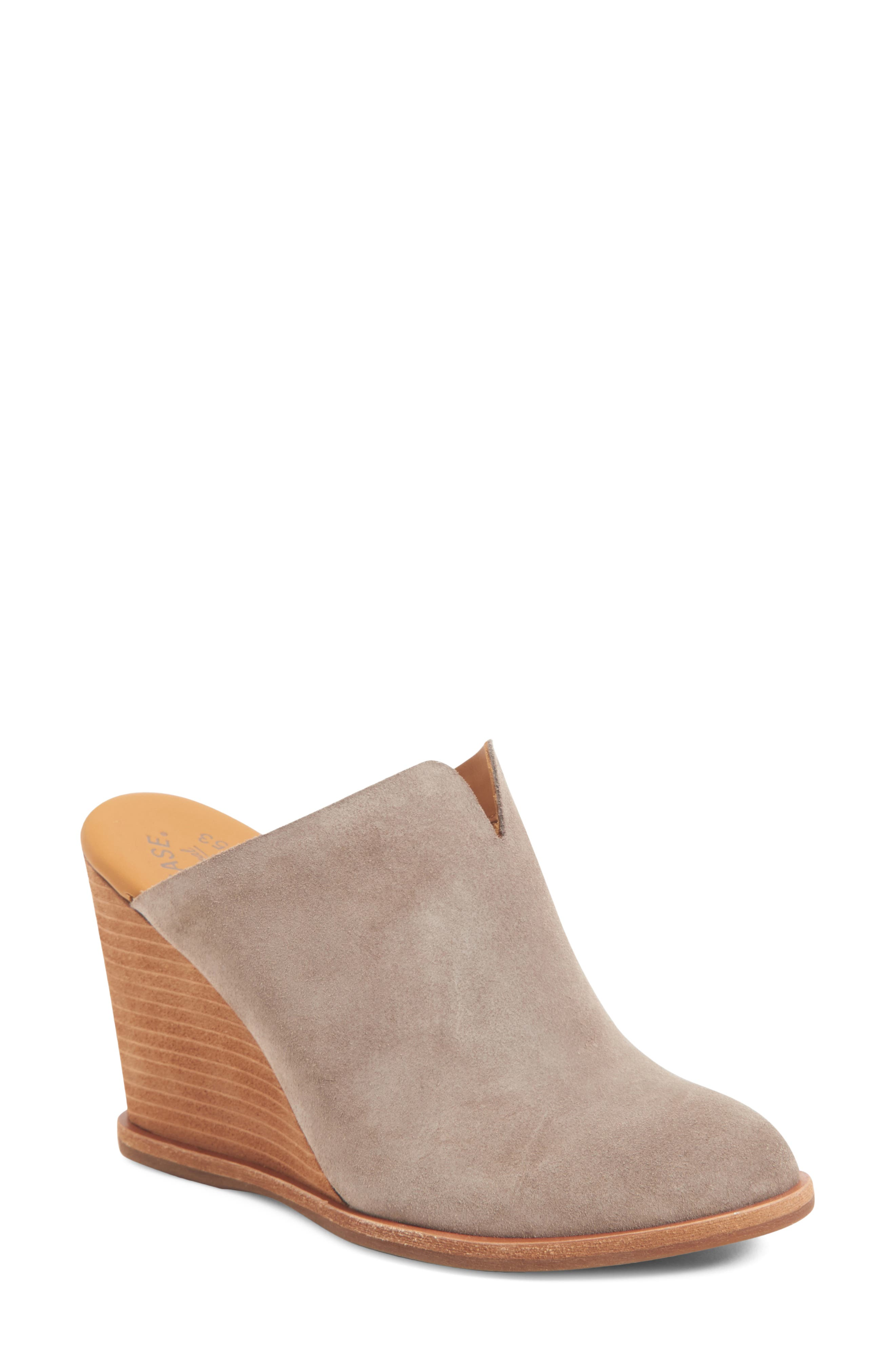 A tall stacked wedge brings eye-catching height to a stylish mule with a notched topline and well-cushioned footbed. Style Name: Kork-Ease Lanka Wedge Mule (Women). Style Number: 6092073. Available in stores.