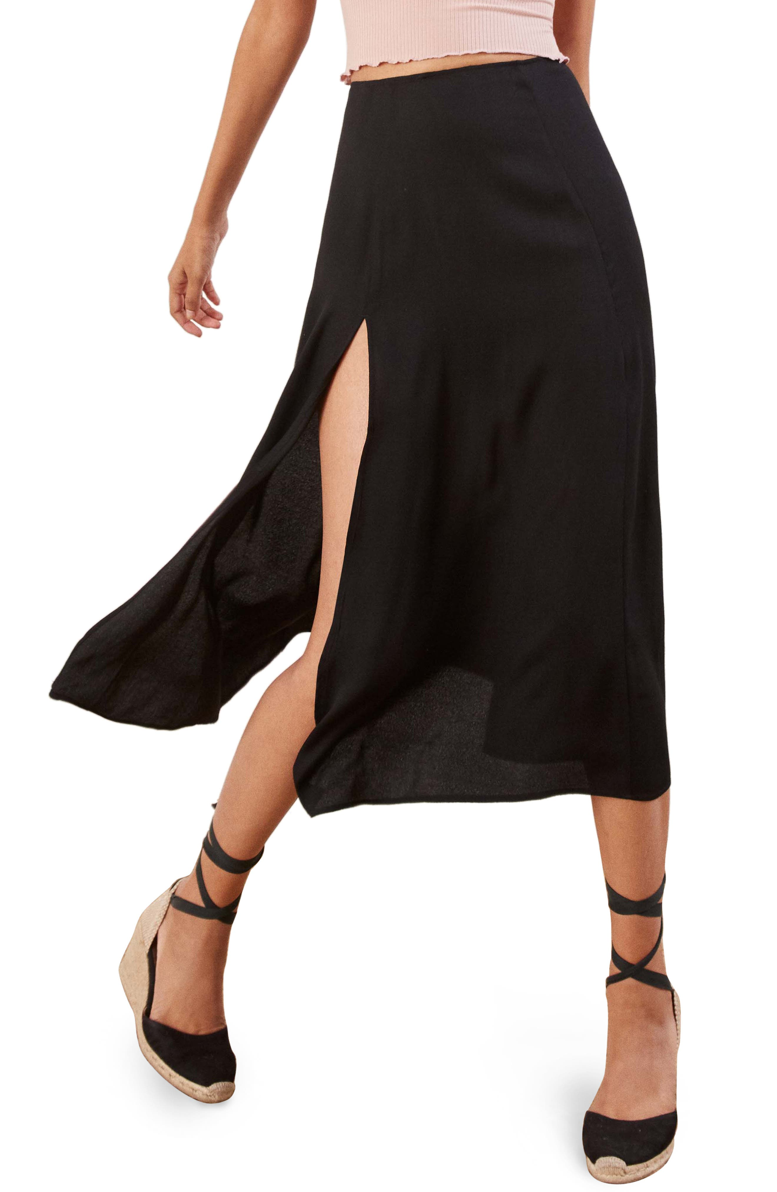 Show and go-go in a side-slashed skirt that let\\\'s you get your groove on. Style Name: Reformation Zoe Side Slit Midi Skirt. Style Number: 6015658 1. Available in stores.