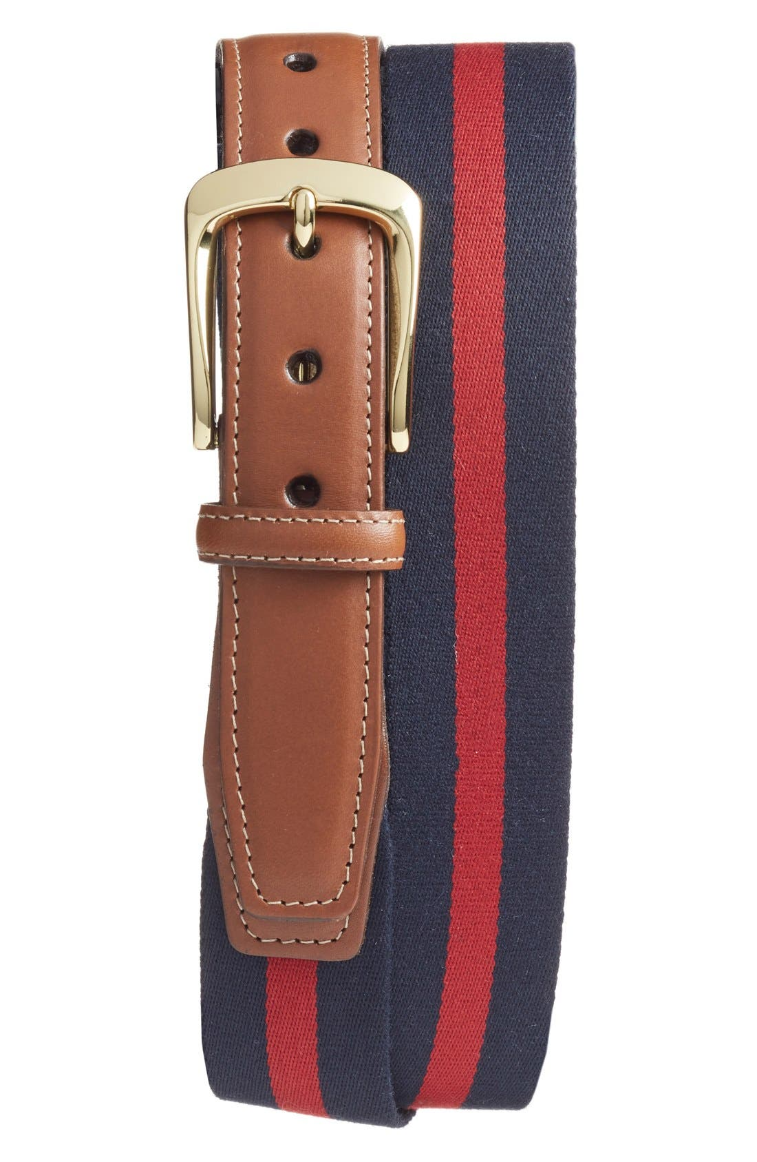 Contrast topstitching and a polished brass buckle add style to a striking surcingle belt that pairs ribbed canvas with supple calfskin leather tabs. Style Name: Torino European Surcingle Belt. Style Number: 5165937. Available in stores.
