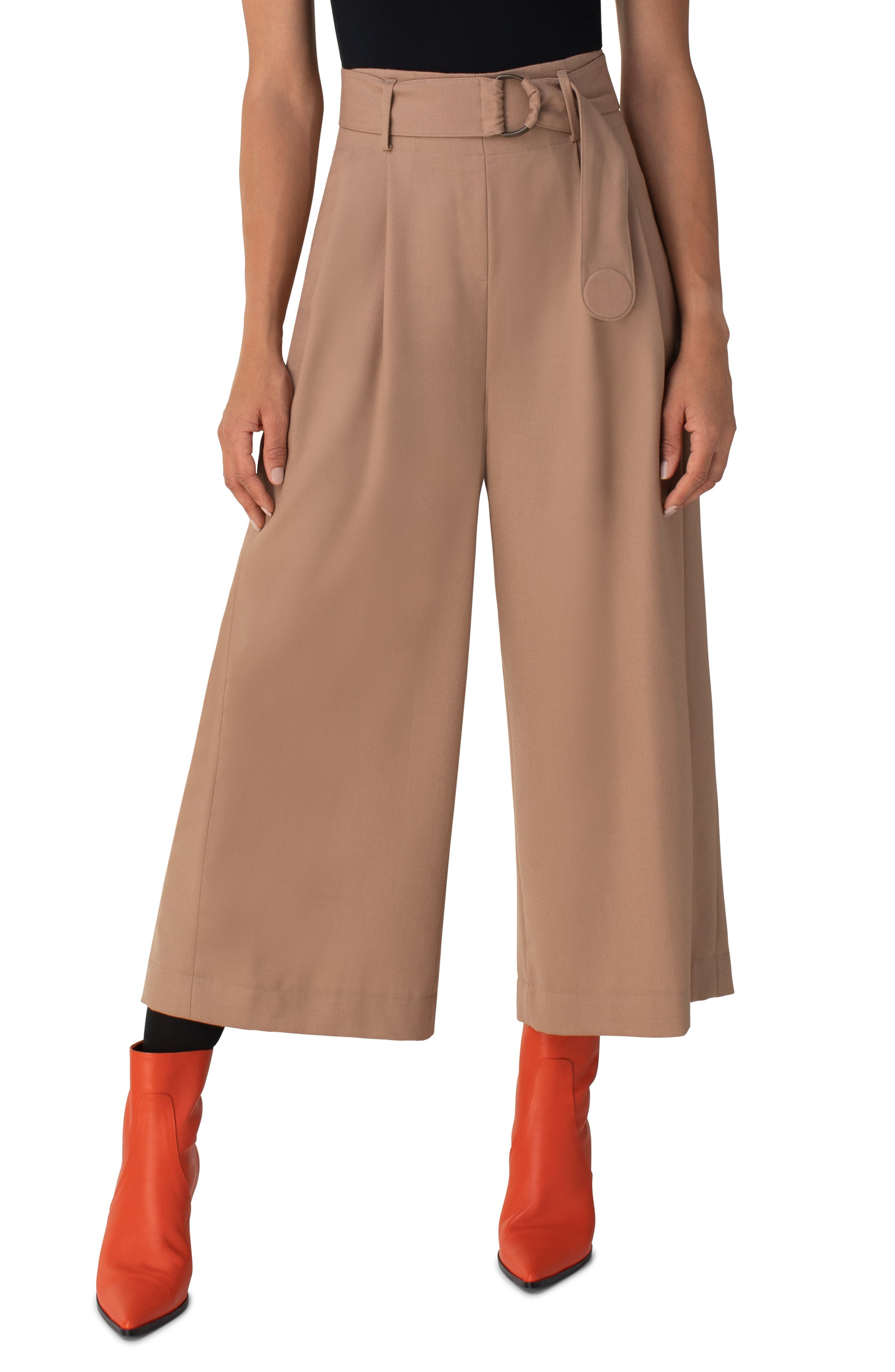 A D-ring belt-stitched with Akris punto\\\'s trademark polka dot-balances the billowy, wide-leg silhouette of these pleated wool culottes. Style Name: Akris Punto Fiorella Belted Wool Flannel Culottes. Style Number: 6046388. Available in stores.