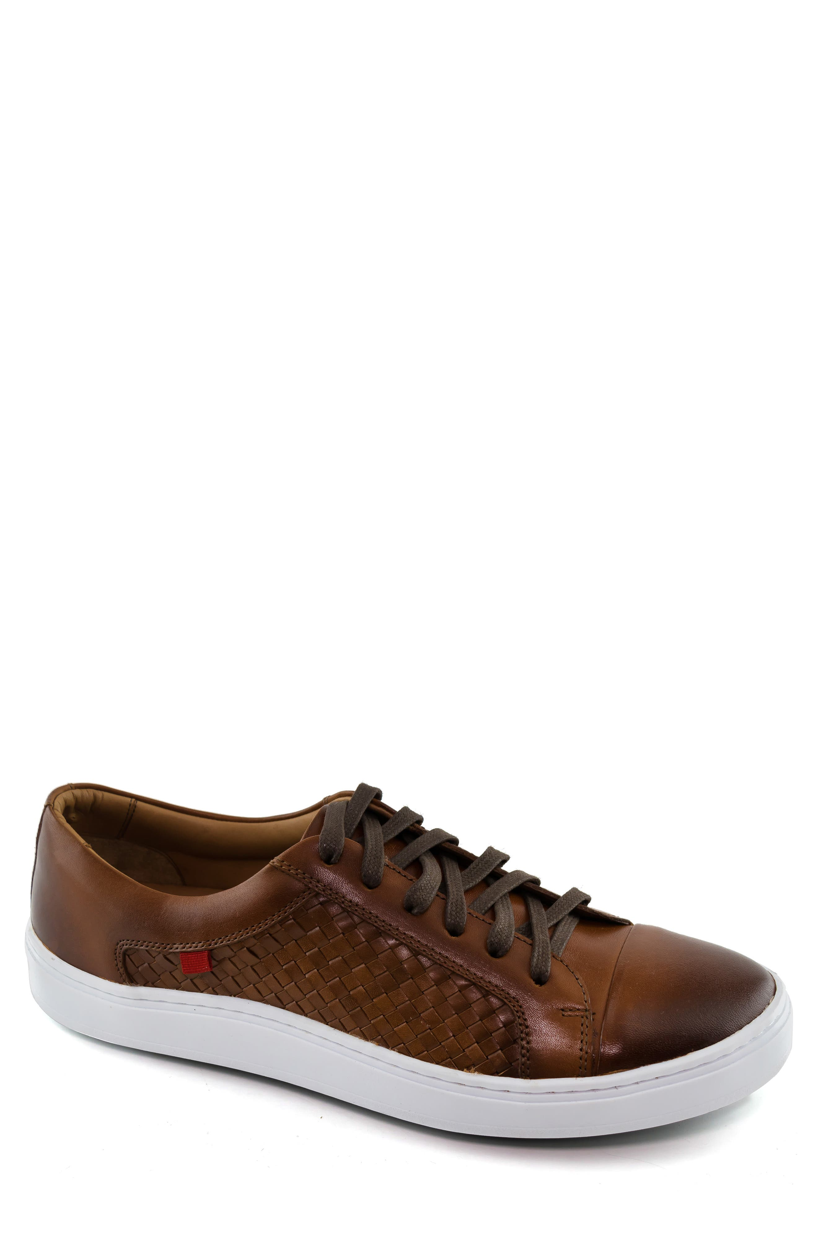 Woven nappa calfskin adds eye-catching texture to a handcrafted sneaker with smart gel cushioning and a flexible traction sole. Style Name: Marc Joseph New York King Street Sneaker (Men). Style Number: 5850495. Available in stores.