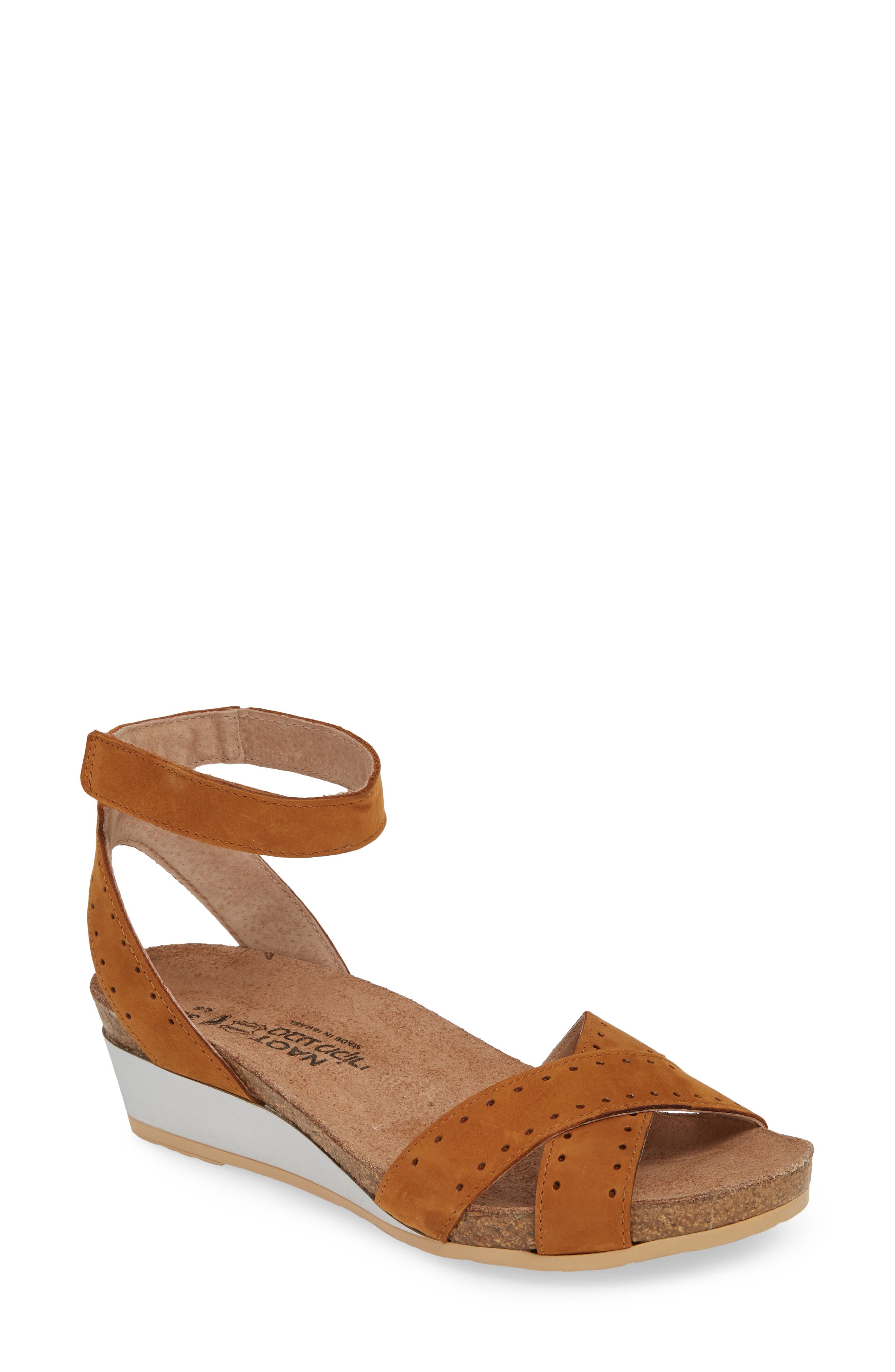 A cork and memory foam footbed adds lightweight comfort to this minimalist ankle-strap sandal. Style Name: Naot Wand Wedge Sandal (Women). Style Number: 5807753. Available in stores.