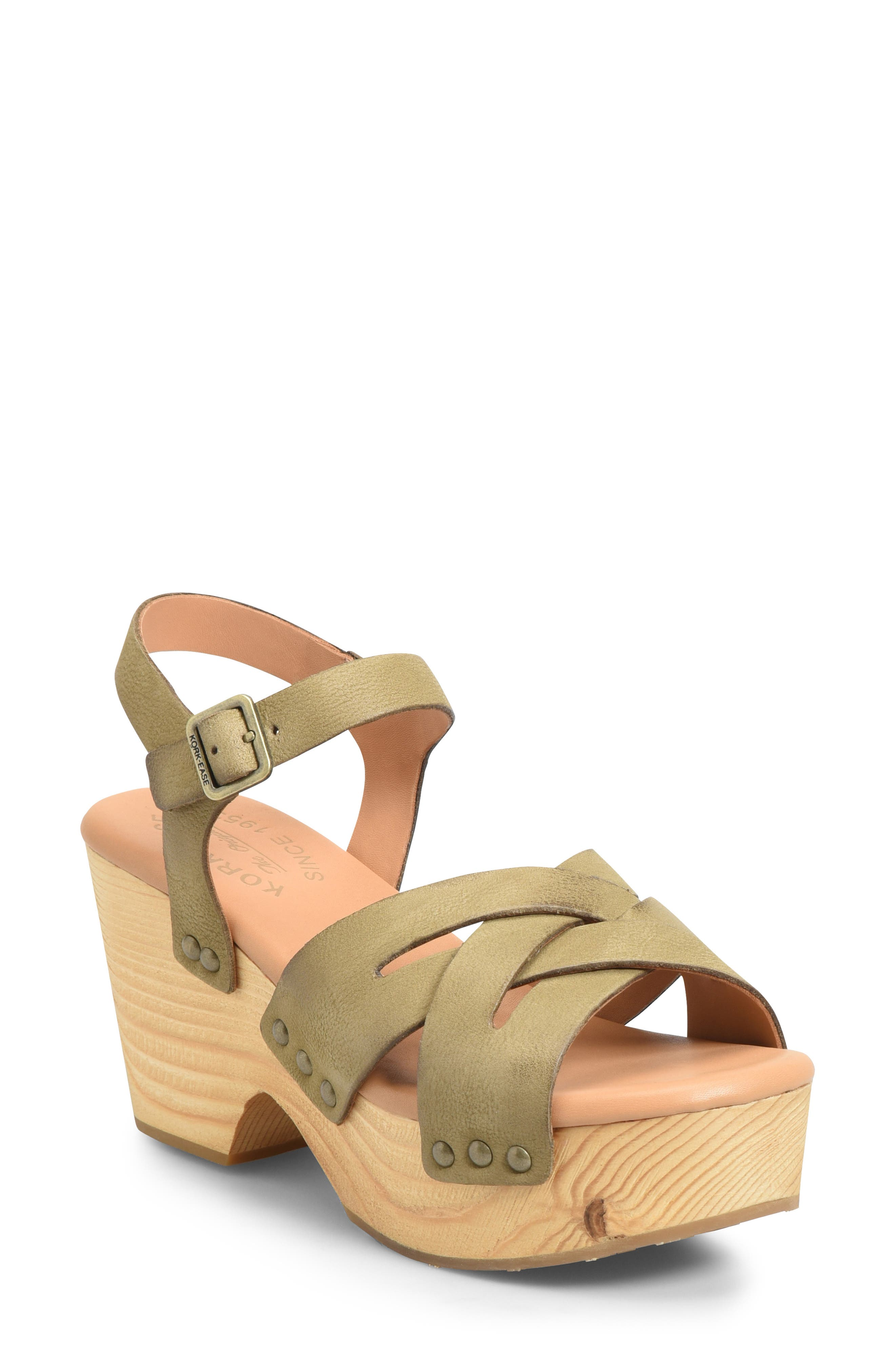 A retro sandal with crisscrossing straps, antique studs and a wood-wrapped platform goes great with all your breezy hemlines this season. Style Name: Kork-Ease Wausau Platform Sandal (Women). Style Number: 5789533 2. Available in stores.