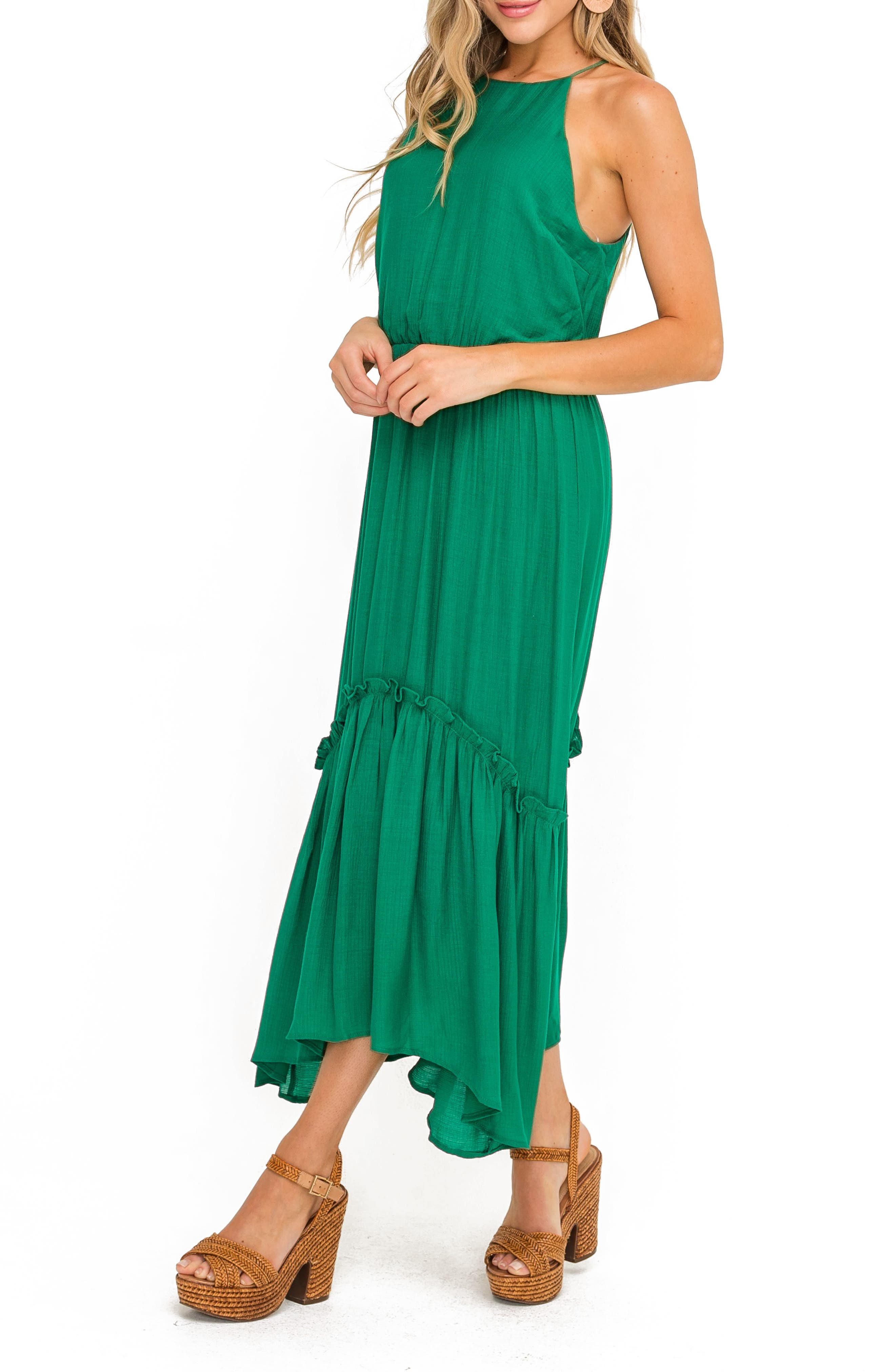A ruffled skirt accentuates the shark-bite hem of a fresh and breezy maxi dress topped with a halter neck. Style Name: All In Favor Halter Maxi Dress. Style Number: 6031984. Available in stores.
