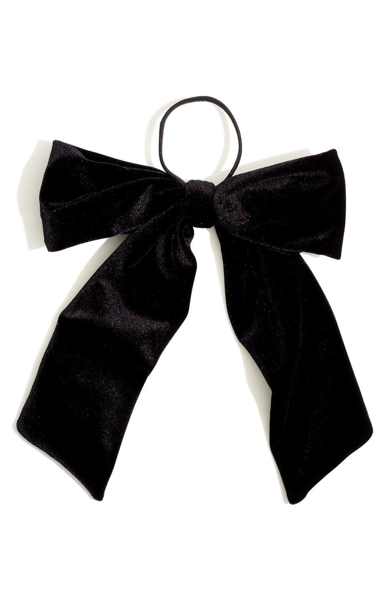 Dress up your ponytail in two seconds with this oversized bow hair tie in luxe velvet-so pretty, sooo easy. Style Name: Madewell Oversize Velvet Bow Hair Tie. Style Number: 6044489. Available in stores.
