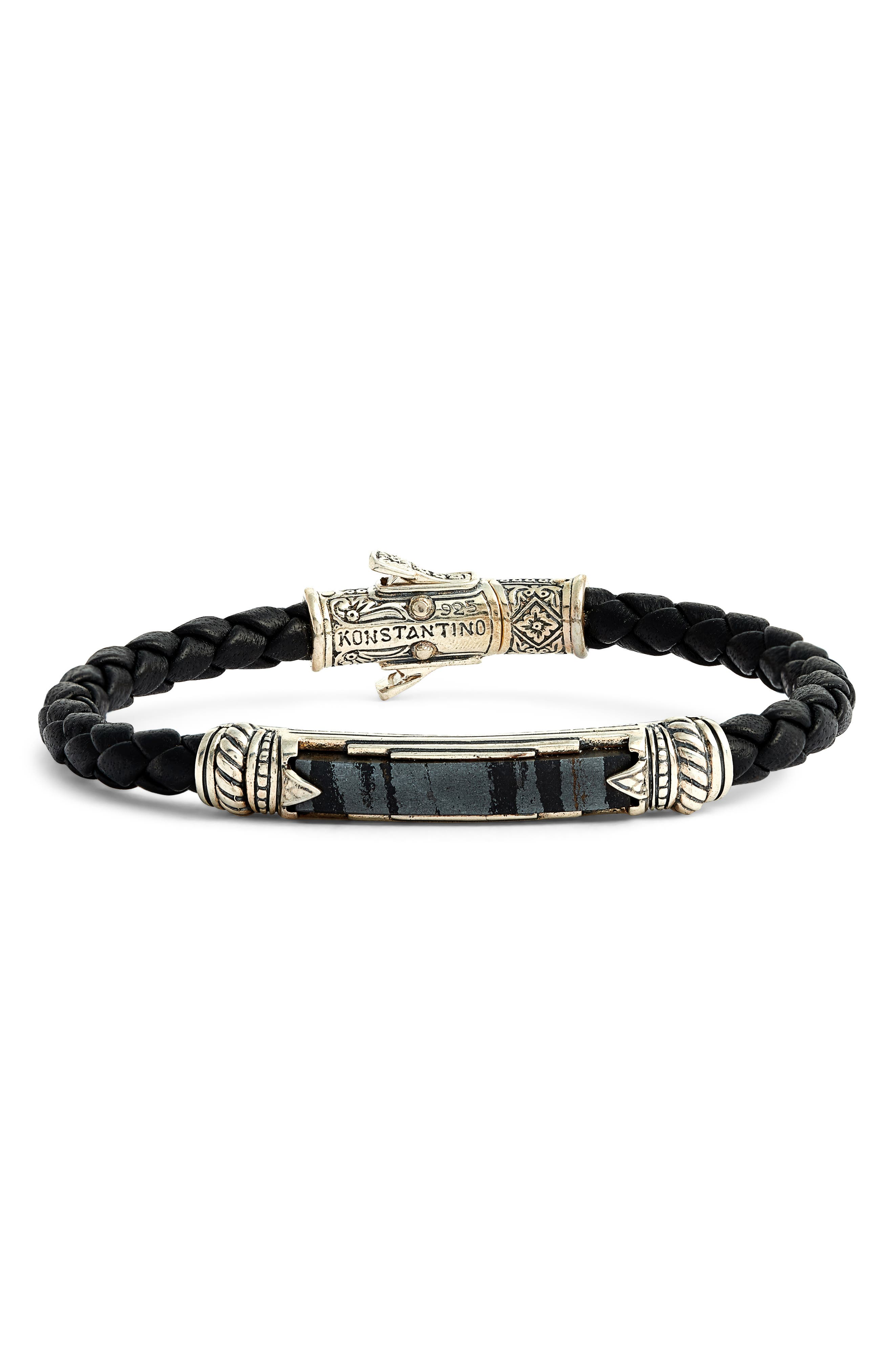 A treasure inspired by ancient Grecian art, this braided leather bracelet is artisan crafted with a ferrite station in a setting of intricately carved sterling silver. A logo-etched clasp of 18-karat gold adds an opulent touch. Style Name: Konstantino Perseus Leather & Ferrite Bracelet. Style Number: 5928161. Available in stores.