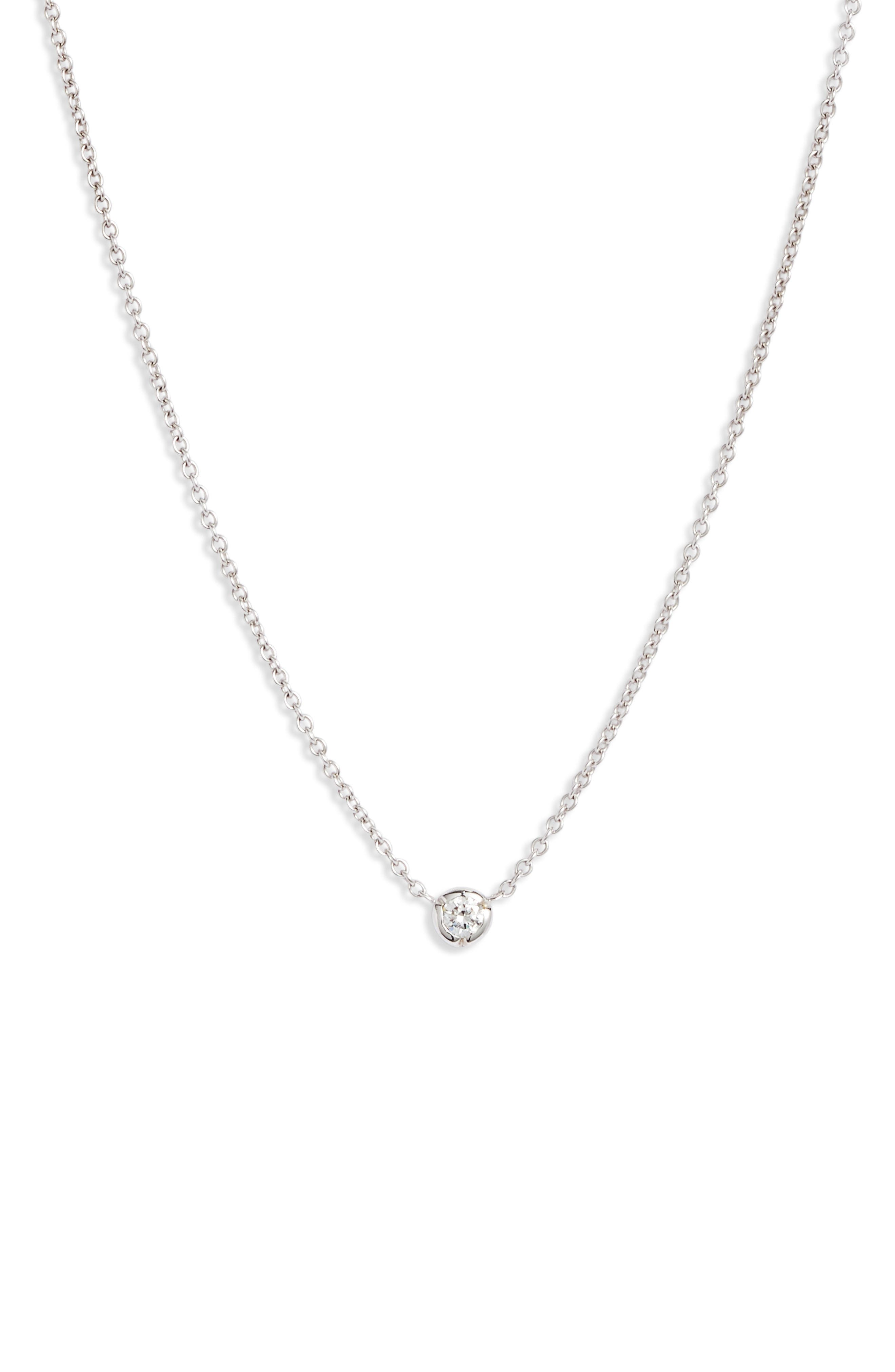 A notched bezel setting updates this tiny solitaire necklace that retains its timeless appeal with a twinkling round diamond and dainty 18-karat-gold chain. Style Name: Bony Levy Petite Bezel Diamond Solitaire Necklace (Nordstrom Exclusive). Style Number: 5895511. Available in stores.